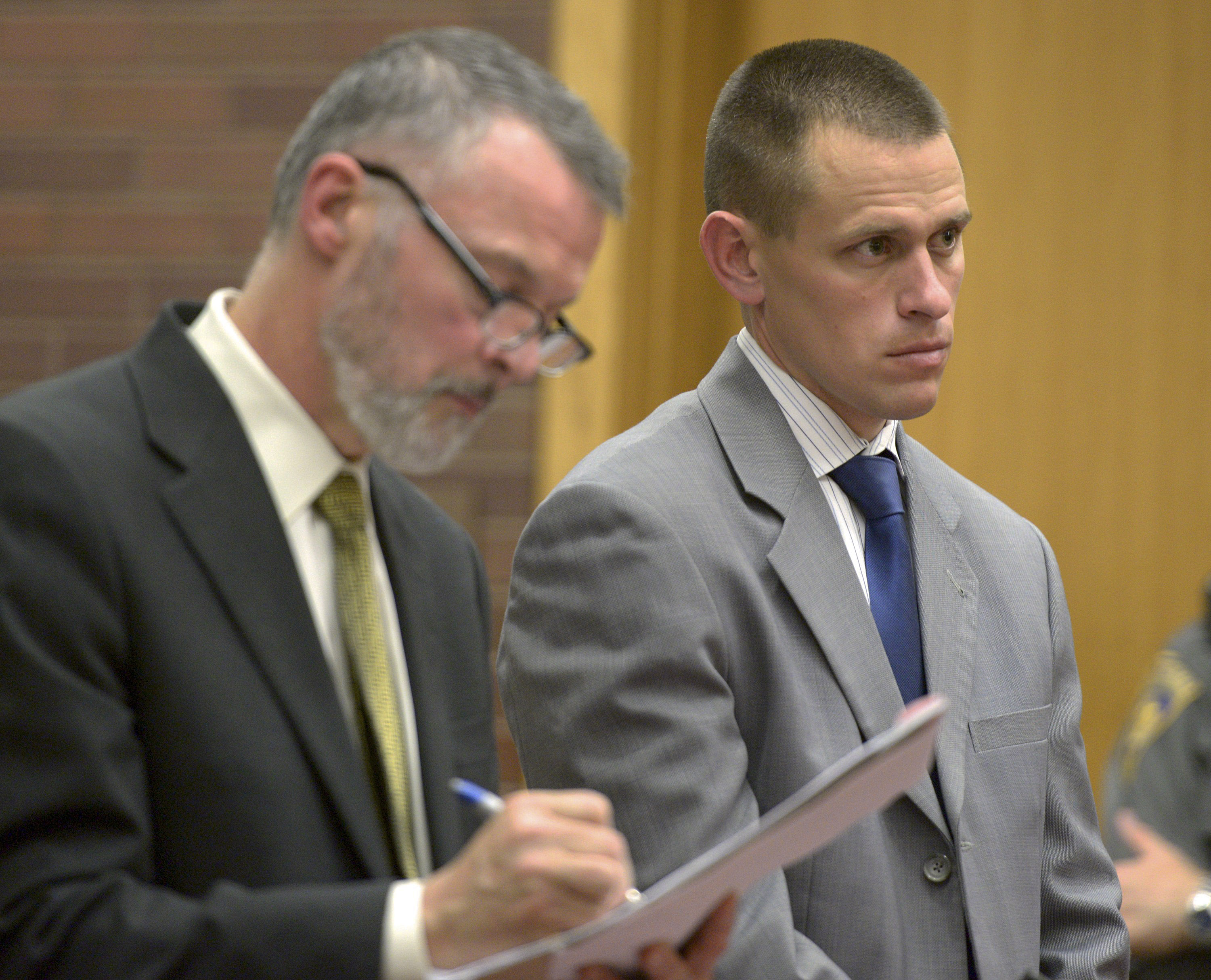 Kyle Seitz, right, of Ridgefield, Conn., stands for arraignment with his attorney John Gulash in Danbury Superior Court in Danbury, Conn., on Nov. 12, 2014