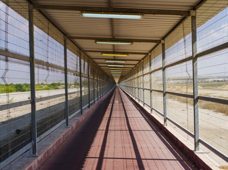 2014.  Gaza.  Palestine.  A caged path leads into and out of Gaza from the Erez crossing in Israel.  When I left, the Israeli border official gave me an Ebola handbook and the only question she asked was whether I'd been to Africa in the previous six months.