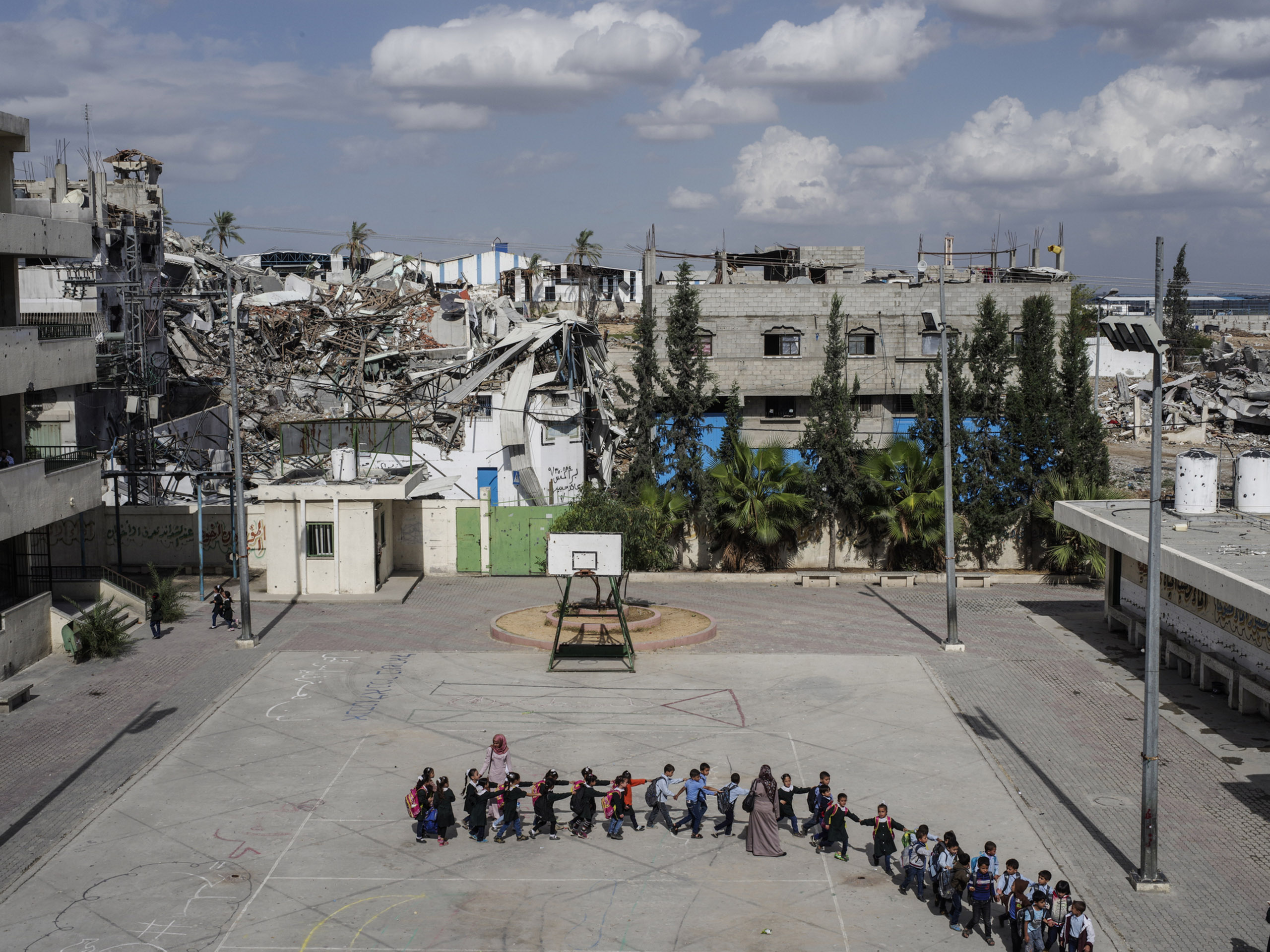 Schoolchildren head to class at the Sobhi Abu Karsh School in the Shujai'iya neighborhood of Gaza.