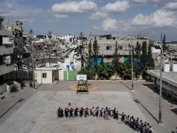 2014.  Gaza.  Palestine.  Schoolchildren head to class at the Sobhi Abu Karsh School in the Shujai'iya neighborhood. Operation Protective Edge lasted from 8 July 2014 – 26 August 2014, killing 2,189 Palestinians of which 1,486 are believed to be civilians. 66 Israeli soldiers and 6 civilians were killed.  It's estimated that 4,564 rockets were fired at Israel by Palestinian militants.
