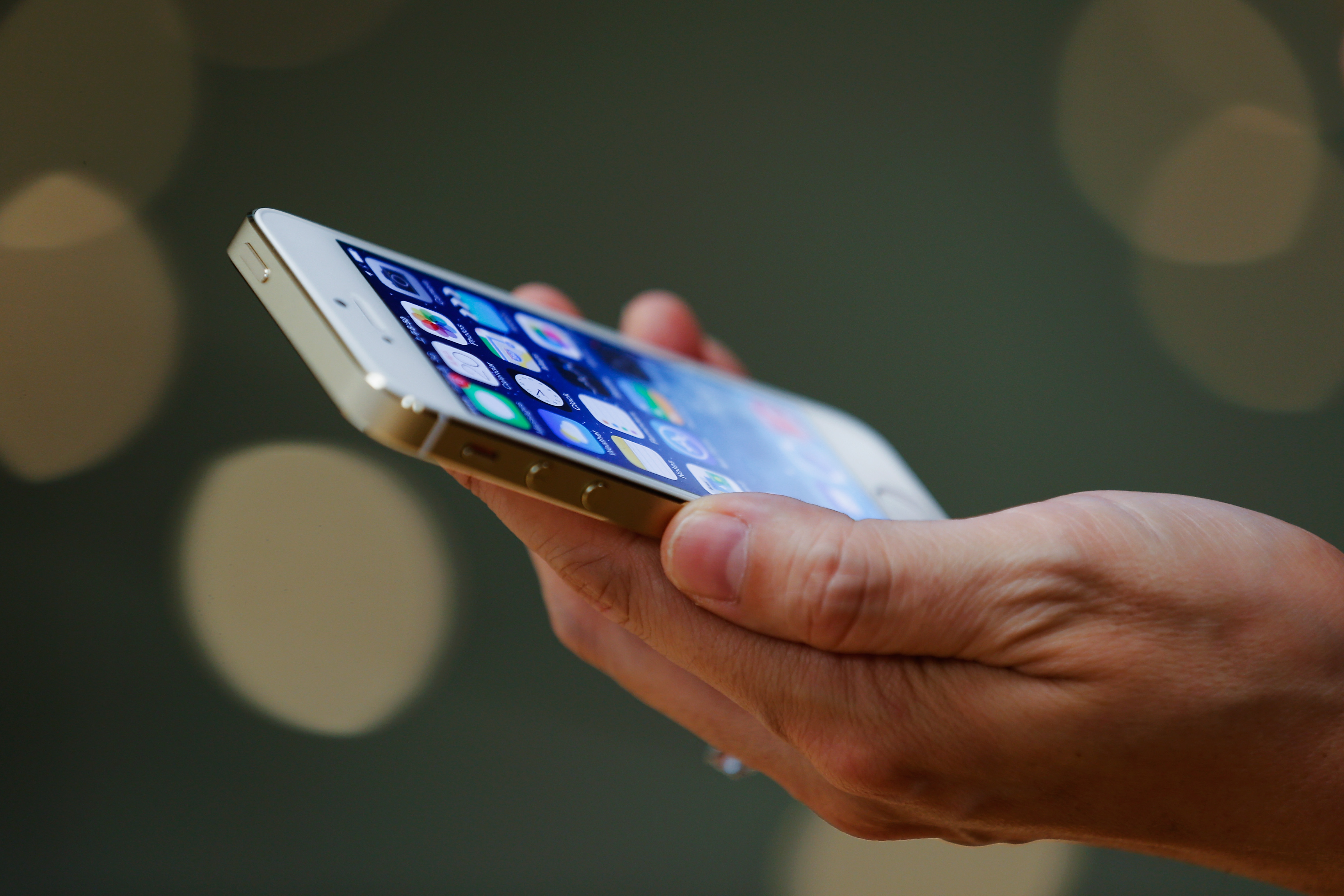 A customer inspects the new iPhone at the Wangfujing flagship store on Sept. 20, 2013 in Beijing,