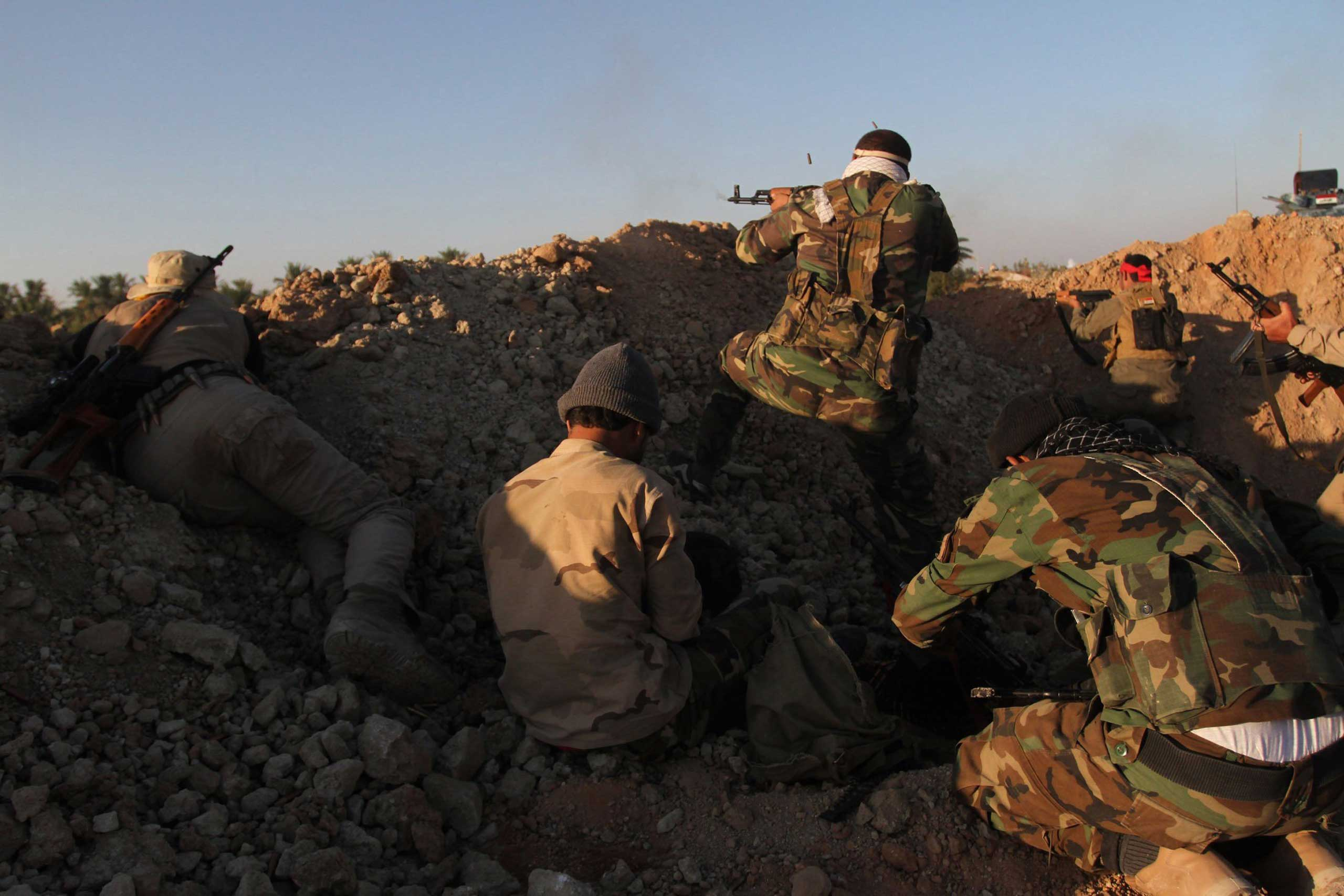 Iraqi government forces and Shiite militias launch an operation against Islamic State of Iraq and Syria (ISIS) militants to take control of Jurf al-Sakhar south of Baghdad, Iraq. on Oct. 25, 2014.