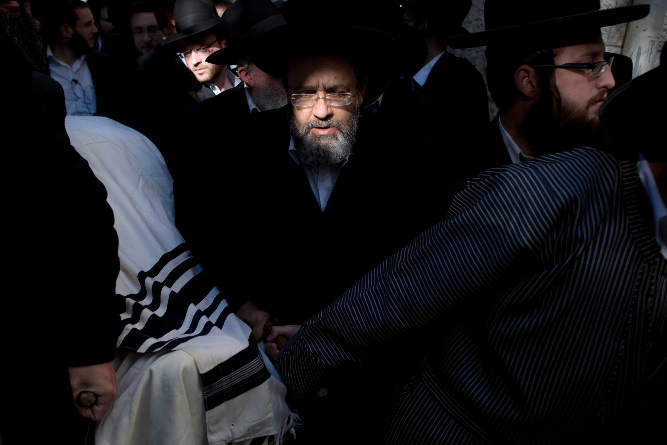 Ultra-Orthodox Jews carry the body of Mosheh Twersky during his funeral in Jerusalem on Nov. 18, 2014.