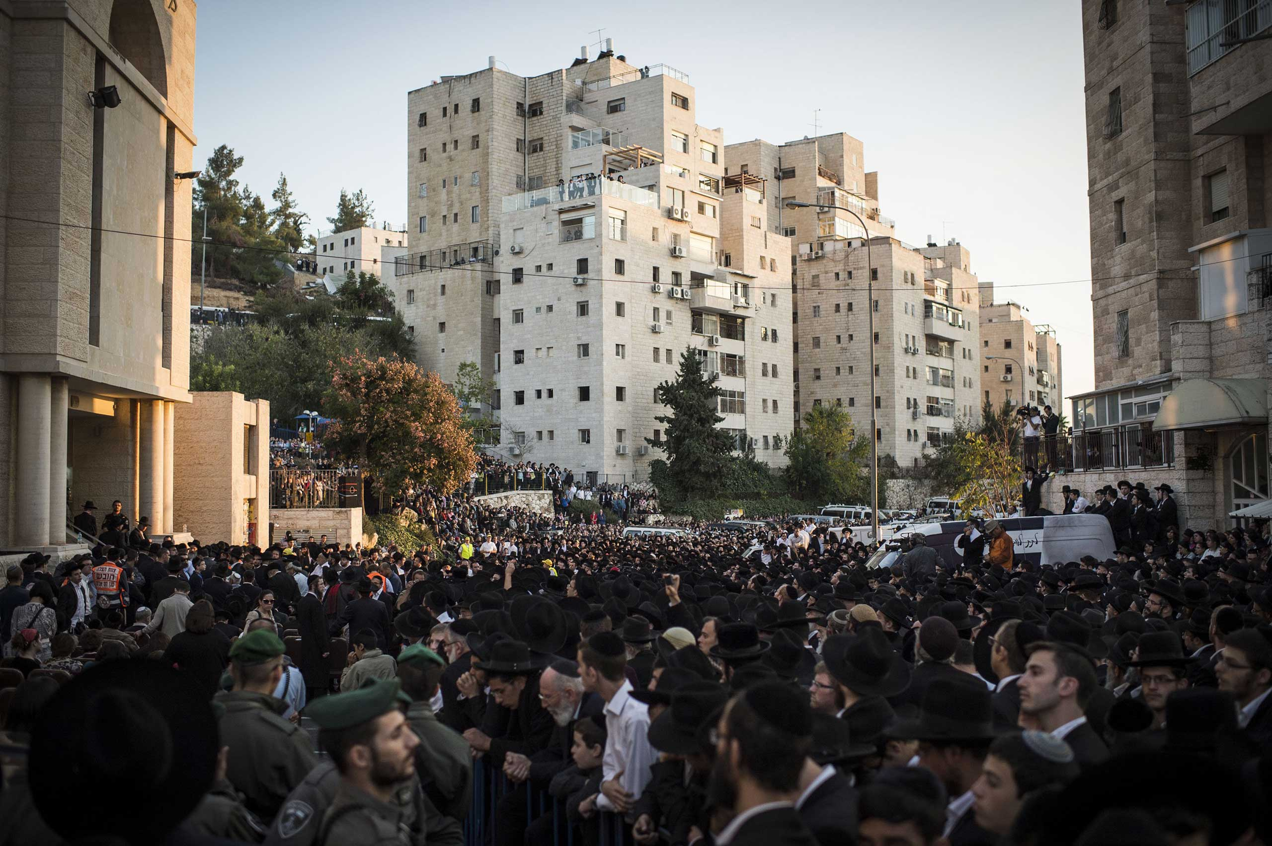 Mourners gather for the funerals of Rabbi Kalman Levine, Avraham Goldberg and Arieh Kupinsky in Jerusalem on Nov.18, 2014.