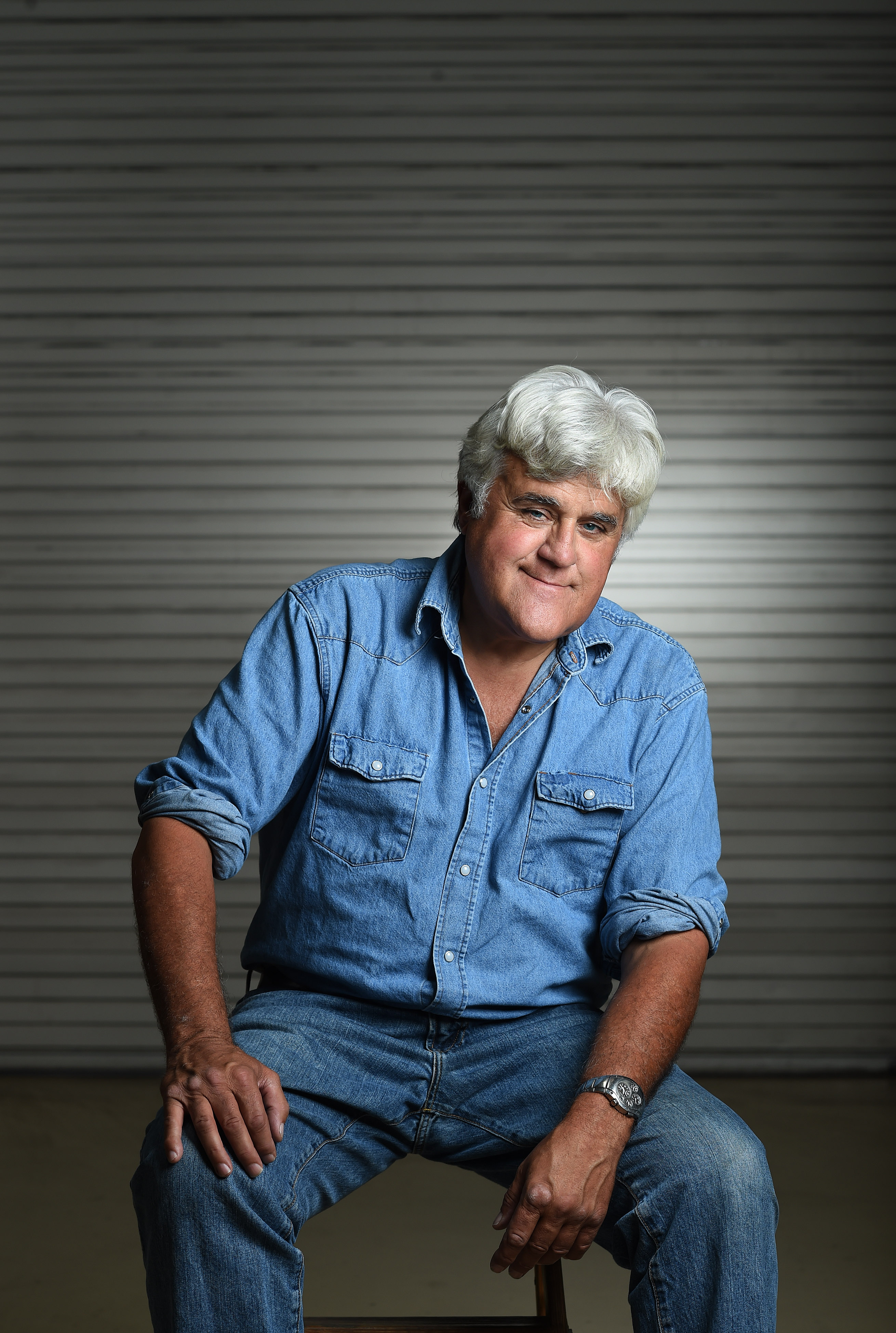 Jay Leno poses for a portrait at his car garage on Sept. 24, 2014 in Burbank, Calif.