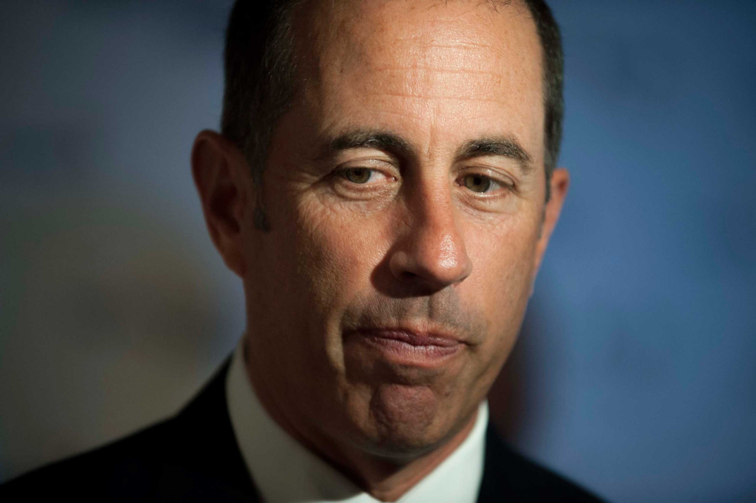 Jerry Seinfeld pauses as he is interviewed on the red carpet at the Kennedy Center for the Performing Arts for the Mark Twain Prize for American Humor, Oct. 19, 2014, in Washington.