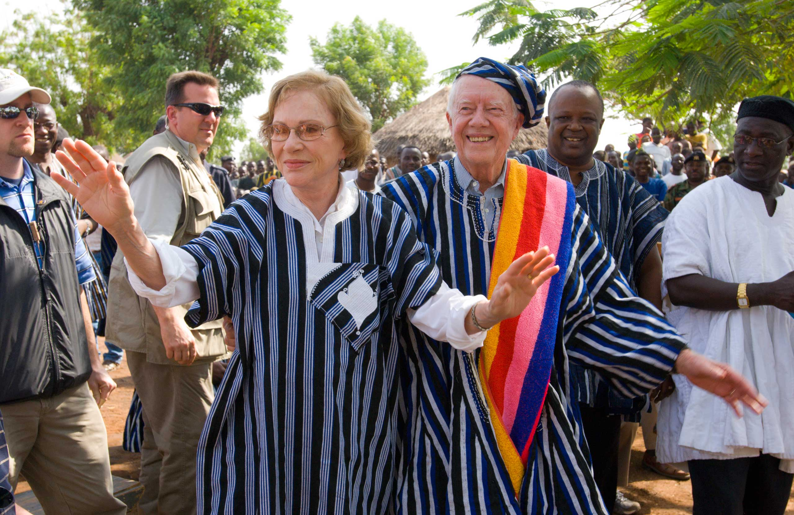 President Jimmy Carter and his wife Rosalynn are honored by the Dagumba people with a gift of traditional attire in Tingoli, Northern Ghana in 2007.