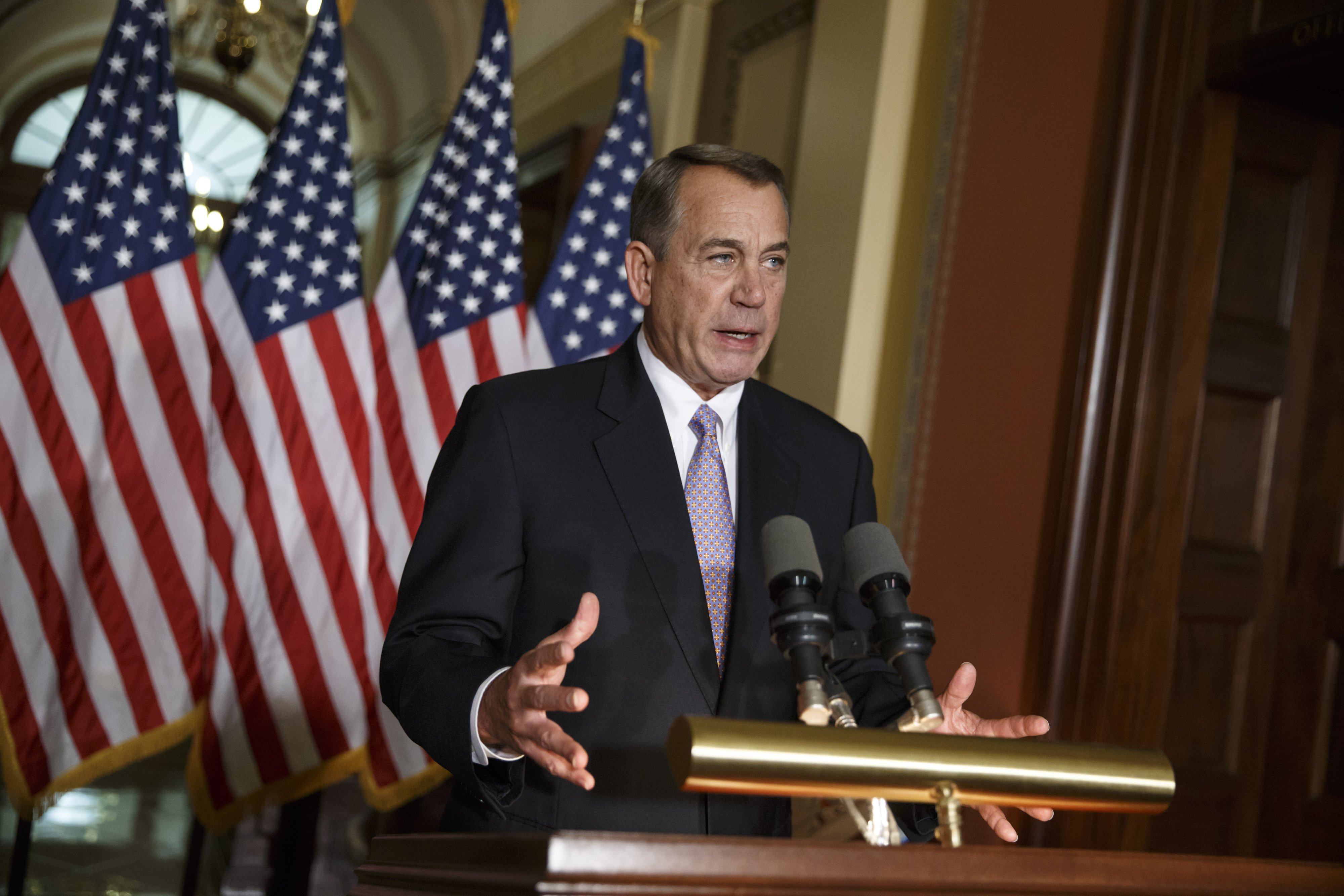 House Speaker John Boehner of Ohio responds to President Barack Obama's intention to spare millions of illegal immigrants from being deported, a use of executive powers that is setting up a fight with Republicans in Congress over the limits of presidential powers on Nov. 21, 2014 in Washington.