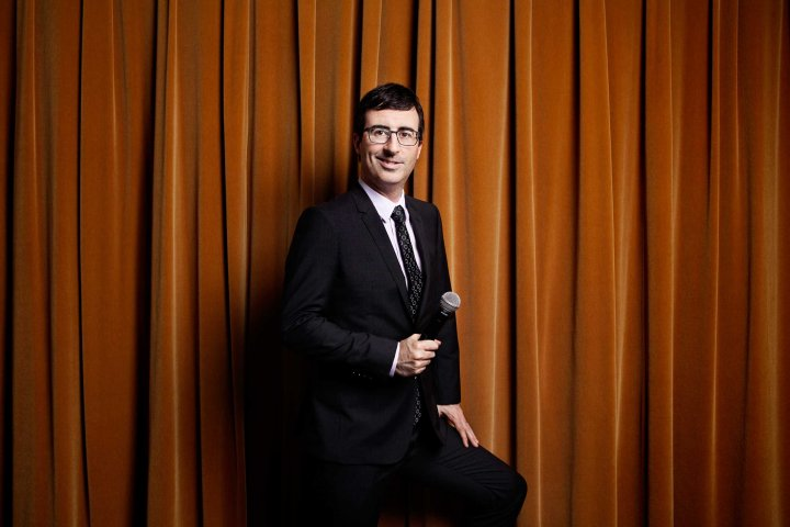John Oliver host of the HBO show Last Week Tonight, sits for a portrait in HBO headquarters in New York City on March 31st, 2014.