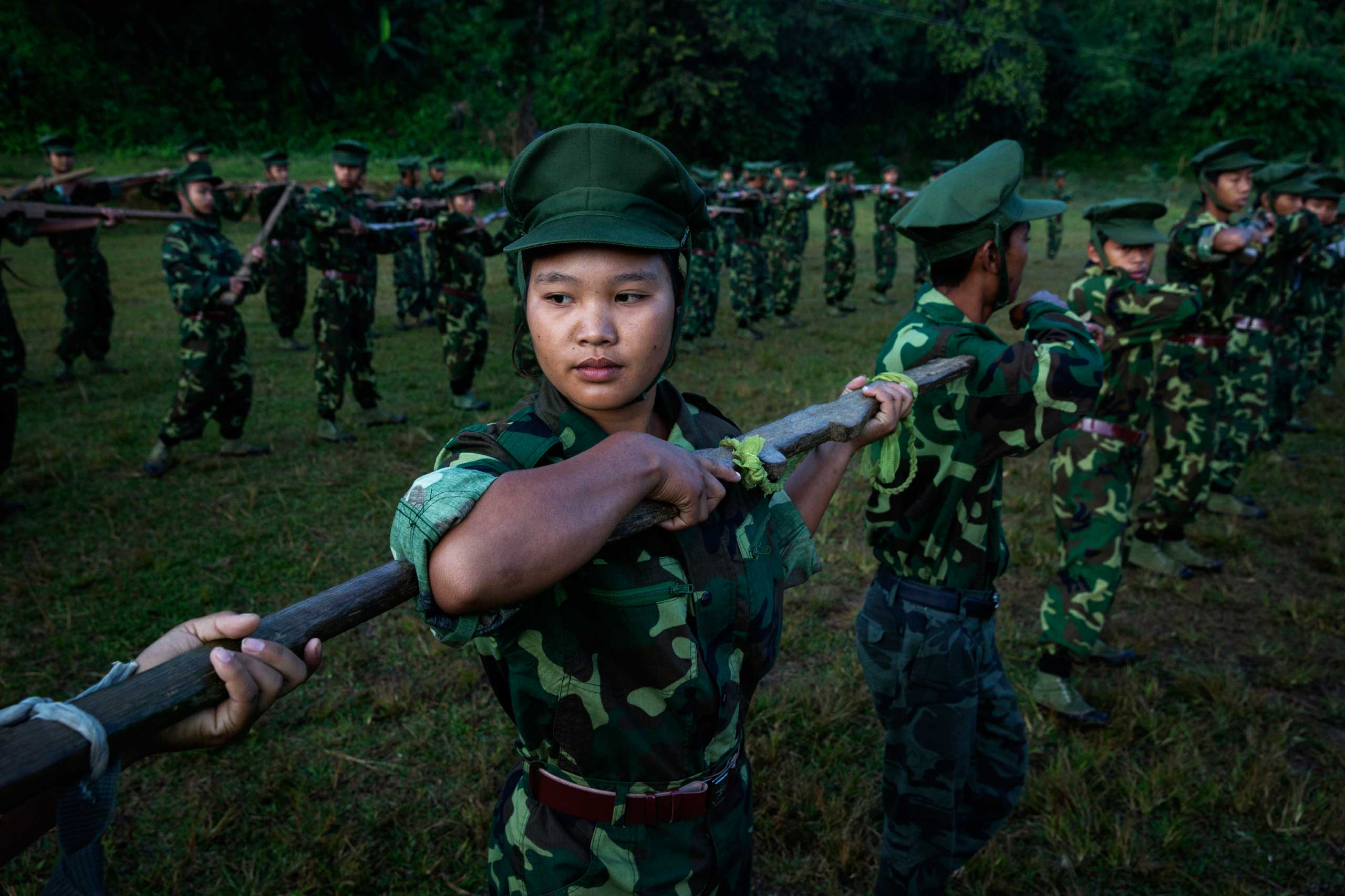 High school and university students receive drill instructions in Laiza, which lies in a Kachin Independence Army–controlled part of Kachin state, in Burma, on Nov. 10, 2014.