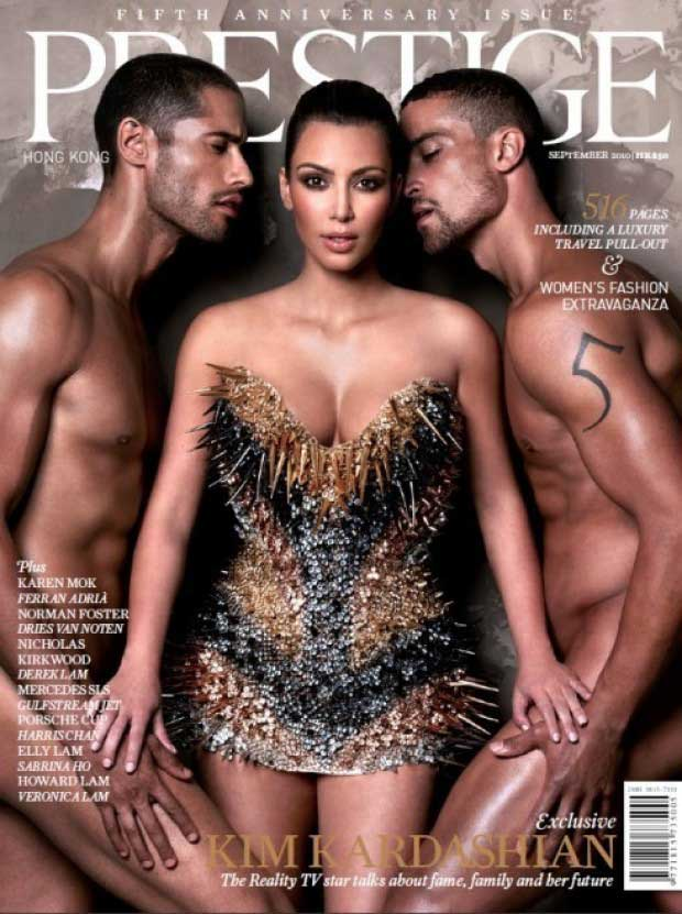 "Kim Kardashian was the most-clothed person on the cover of <i>Prestige</i> magazine's September 2010 issue when she posed with two naked men while looking like a sexed-up gladiator. ""This might be one of my most risque covers to date!"" she tweeted."