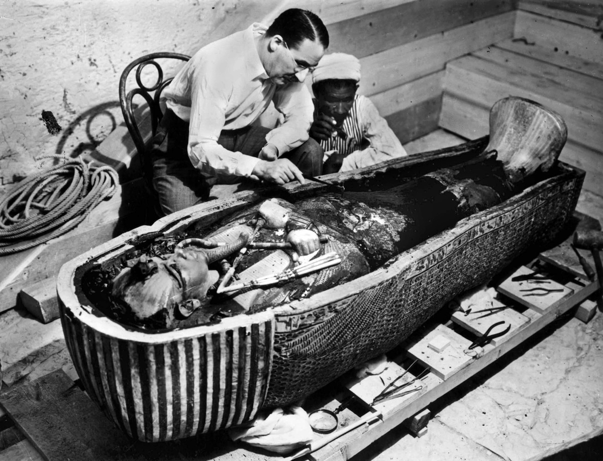 Howard Carter, English Egyptologist, near golden sarcophagus of Tutankhamon in Egypt in 1922