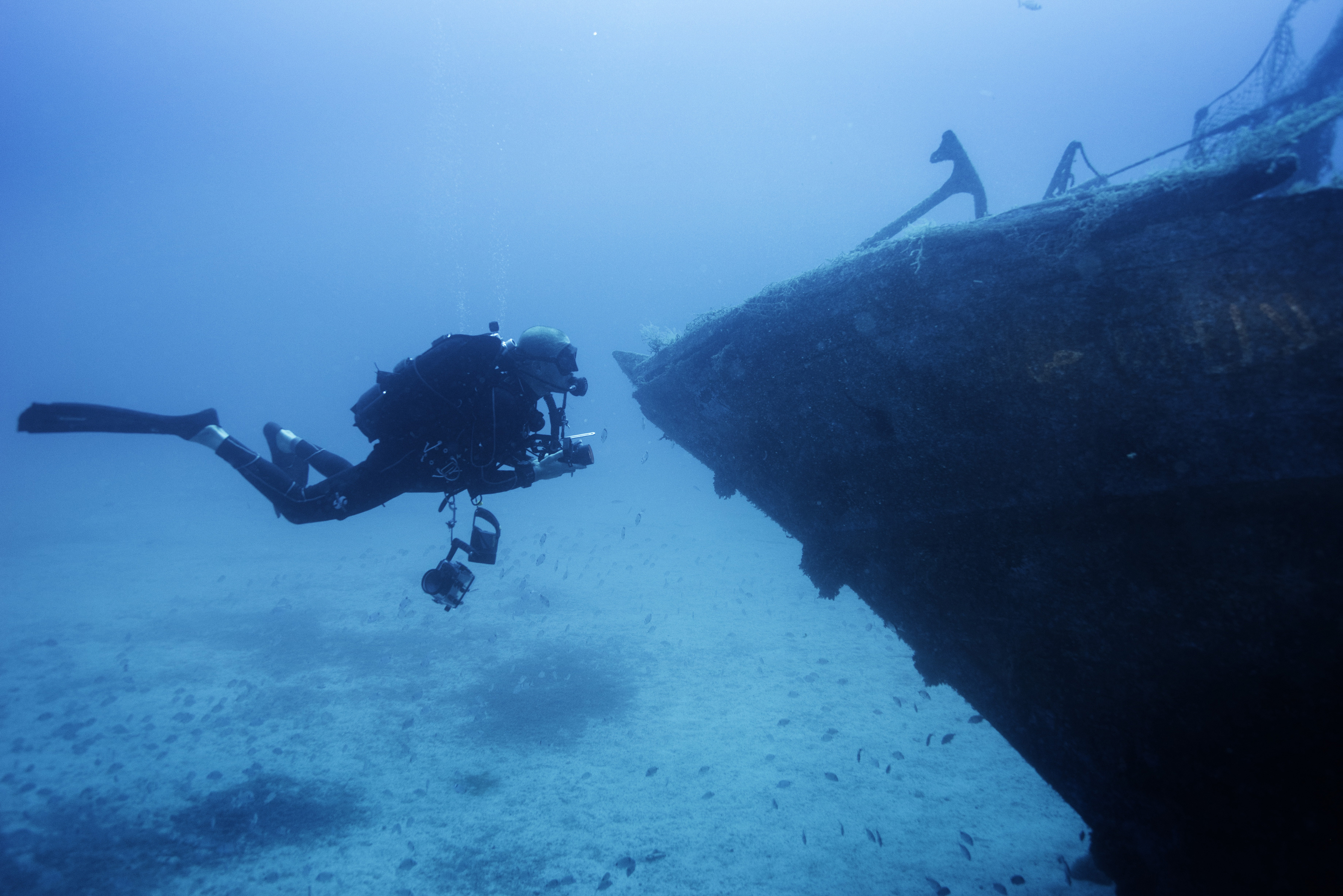 A scuba-diver inspects the shipwreck of the 66-foot-long fishing boat that sank off the coast of the Italian island of Lampedusa lies at a depth of 164 ft. on the seabed, on Sept. 22, 2014. The tragedy that happened a year ago on Oct. 3, 2013 killed 366 migrants from North Africa.