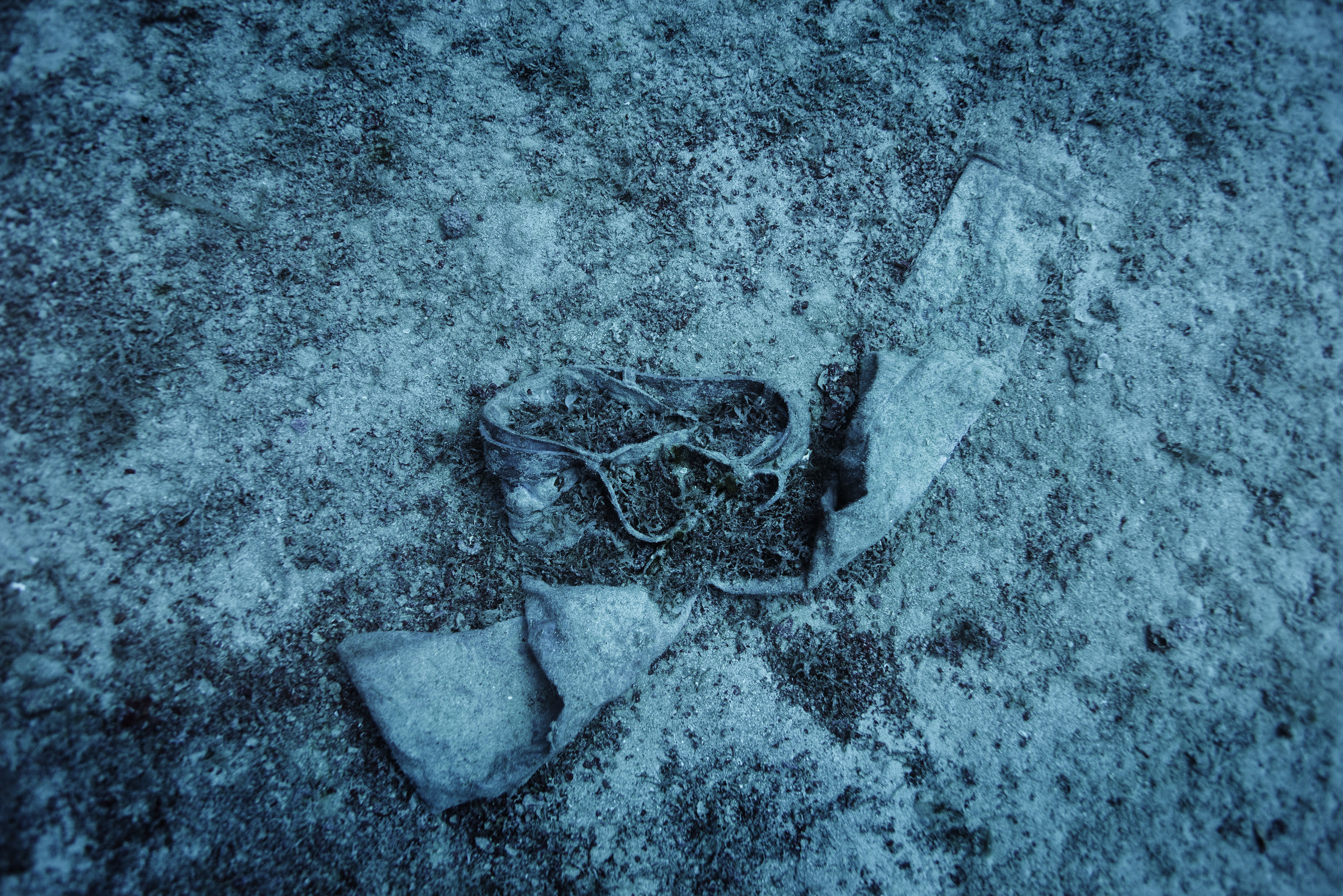 A pair of trousers lie on the seabed near the shipwreck of the 66-foot-long fishing boat that sank off the coast of the Italian island of Lampedusa lies at a depth of 164 ft. on the seabed, on Sept. 22, 2014. The tragedy that happened a year ago on Oct. 3, 2013 killed 366 migrants from North Africa.