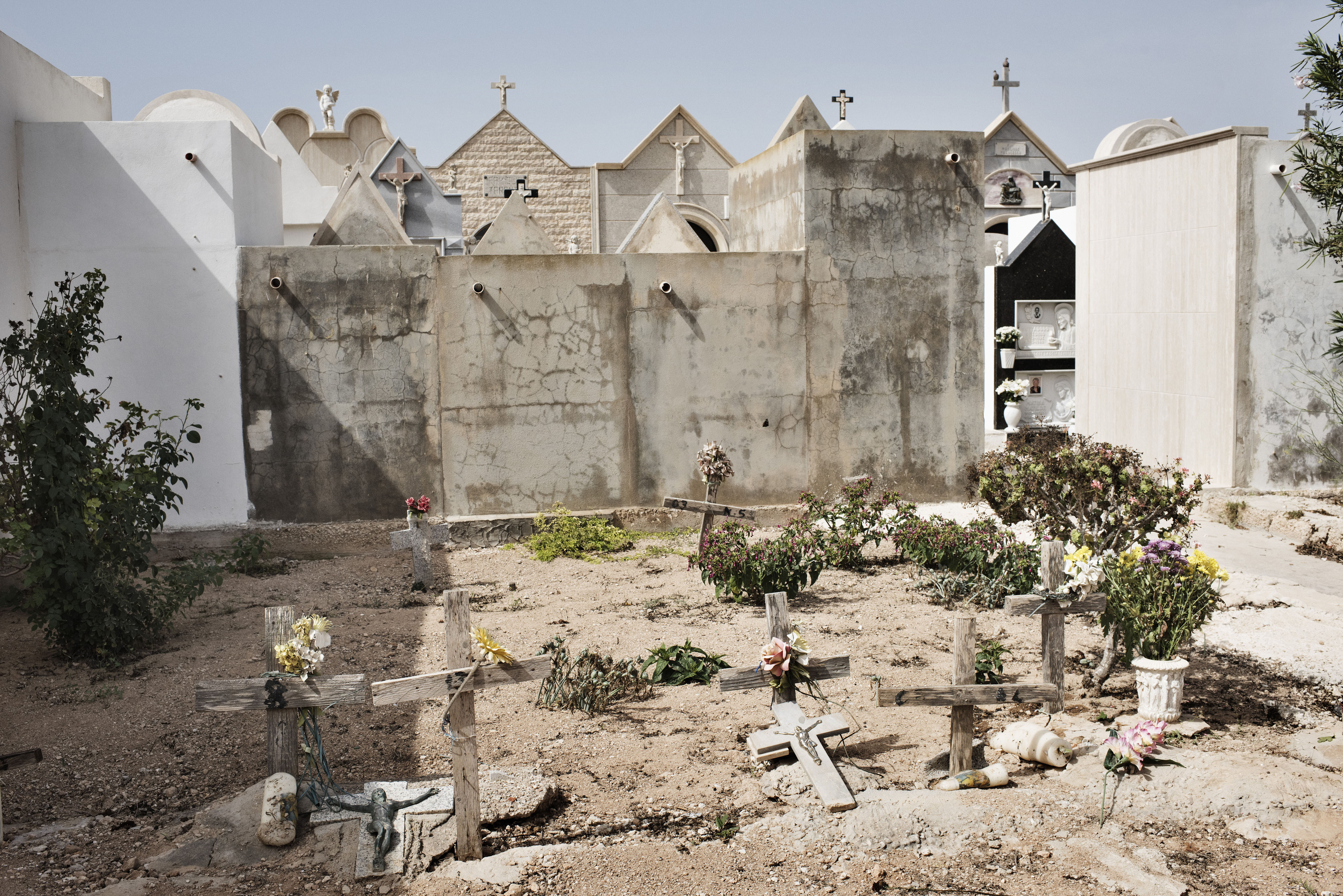 The nameless graves in the cemetery belong to unidentified migrants found dead on the beach of Lampedusa in Italy.