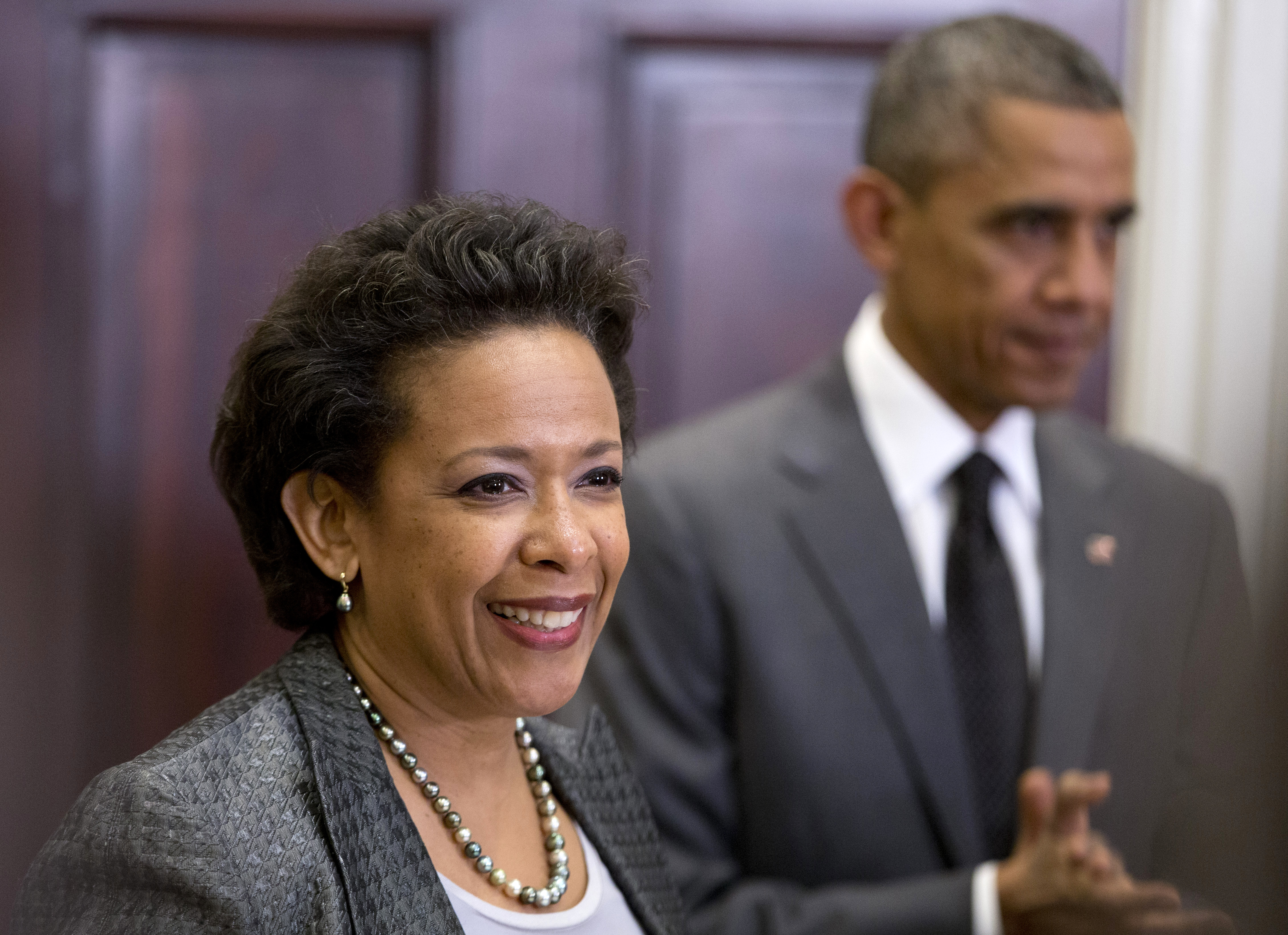 President Barack Obama listens at right as US Attorney Loretta Lynch speaks in the Roosevelt Room of the White House in Washington on Nov. 8, 2014.