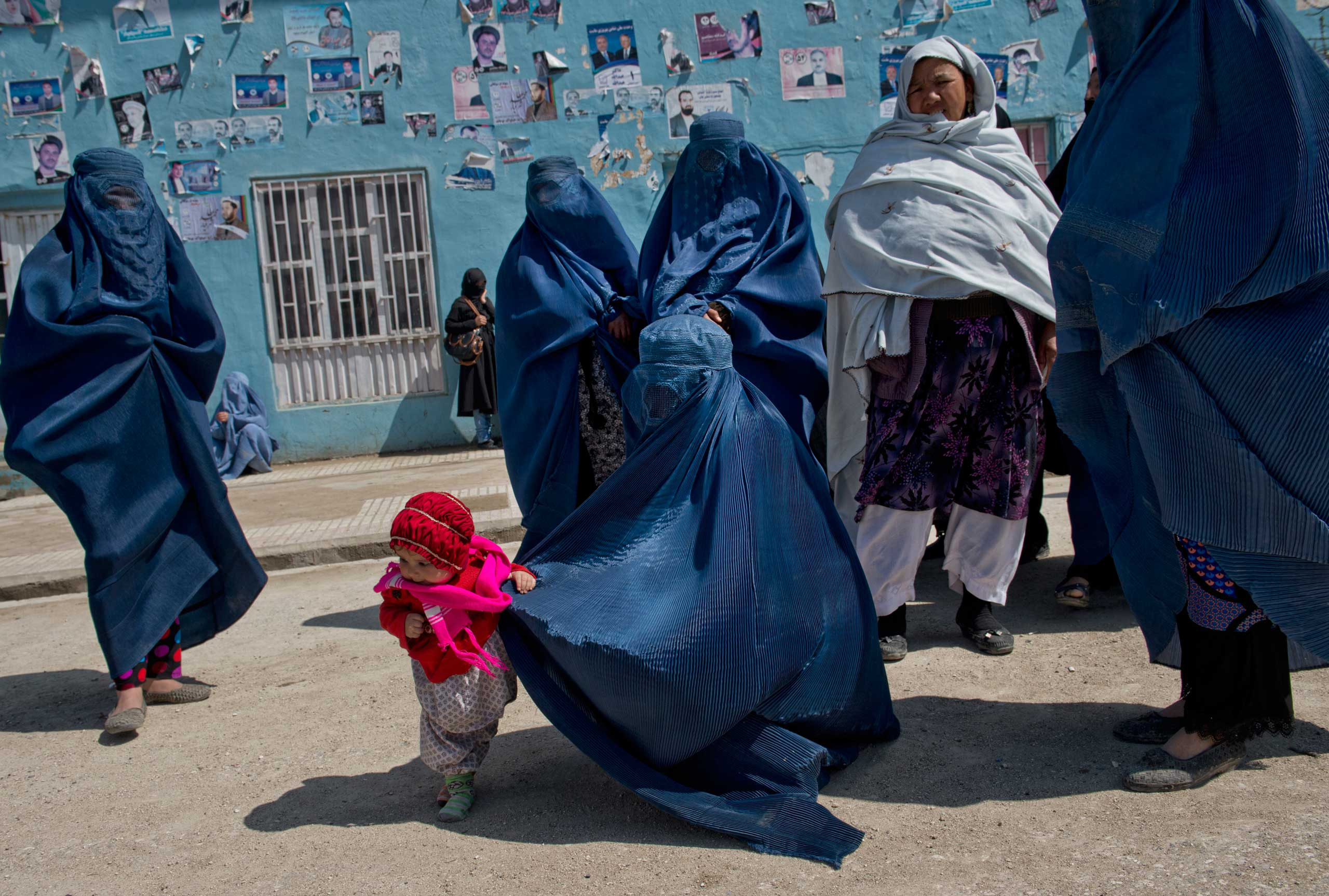 March 27, 2014. Afghan women leave a rally for presidential hopeful Zalmai Rassoul. From  And Women Shall Lead: Lynsey Addario on the New Face of Afghanistan