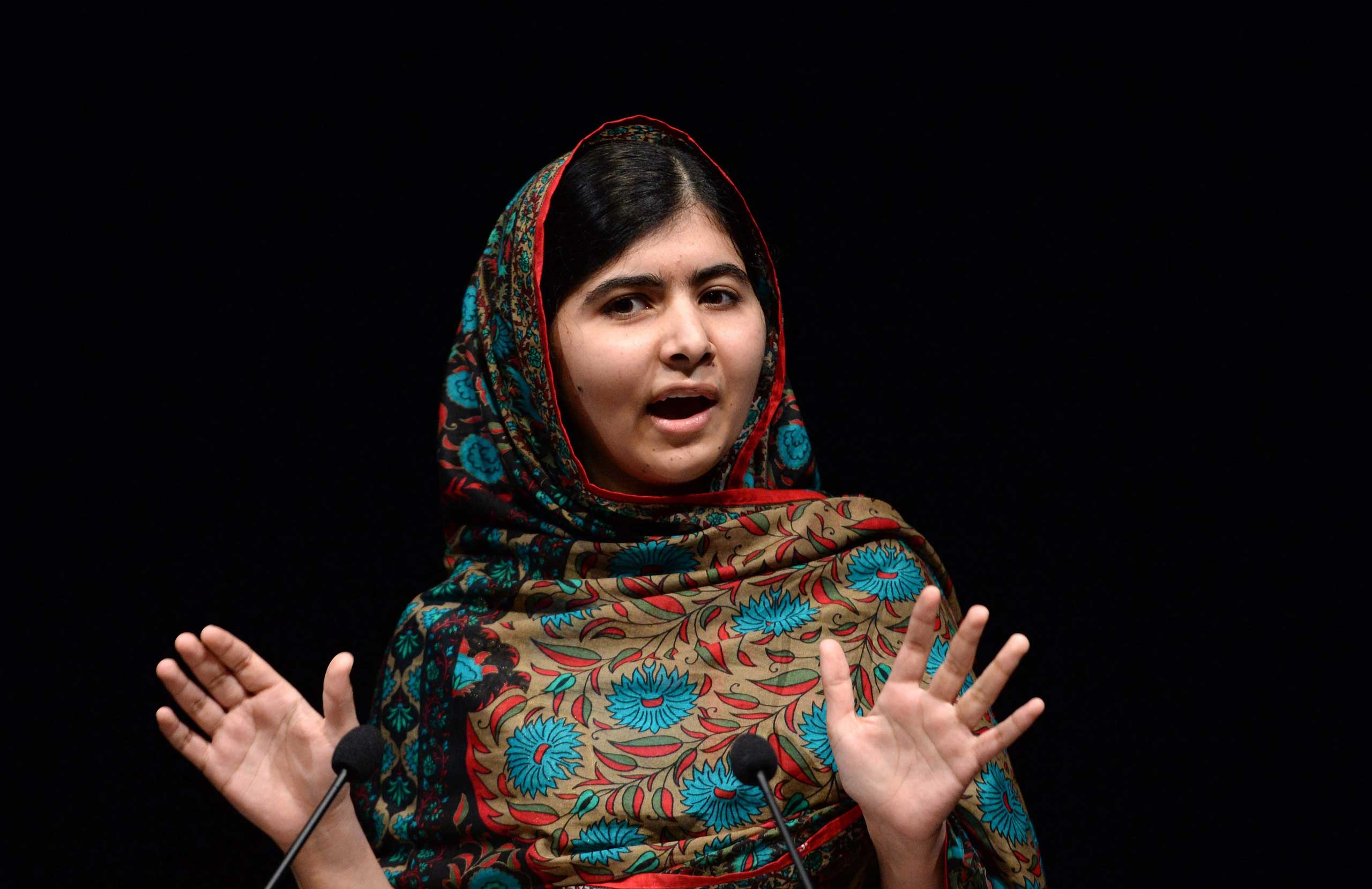 Malala Yousafzai of Pakistan delivers a statement after winning the Nobel Peace Prize in the Library of Birmingham in Birmingham, England on Oct. 10, 2014.