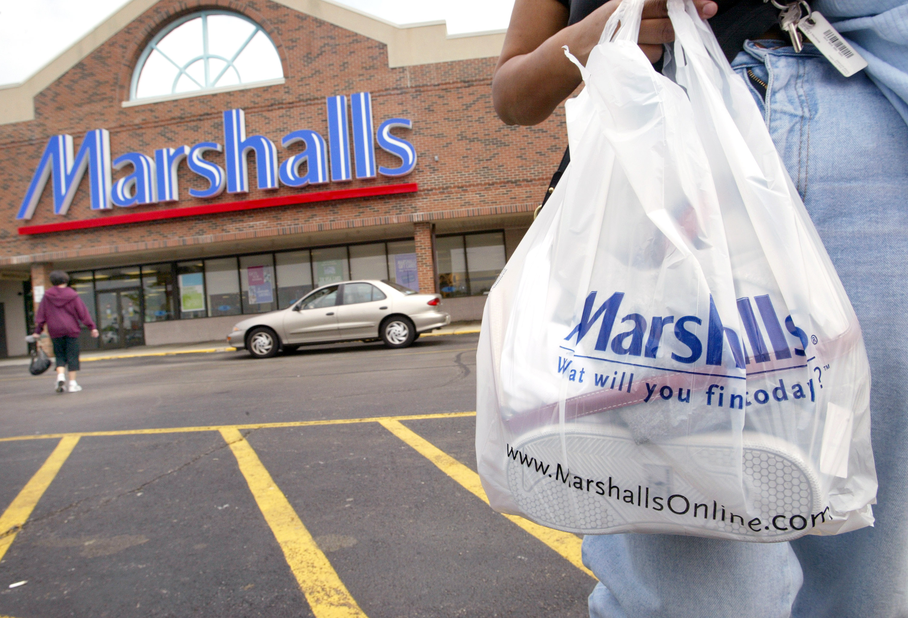 MOUNT PROSPECT - MAY 19:  A shopper with her purchases walks to her car outside a Marshalls store May 19, 2004 in Mount Prospect, Illinois. T.J. Maxx' and Marshalls' parent company TJX Cos. posted a 48 percent first-quarter rise in profit. Sales alone from the T.J. Maxx and Marshalls stores rose 12.6 percent from last year.  (Photo by Tim Boyle/Getty Images)