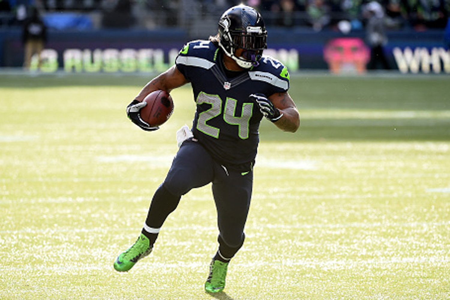 Marshawn Lynch #24 of the Seattle Seahawks runs the ball in the first quarter against the Arizona Cardinals during their game at CenturyLink Field on November 23, 2014, in Seattle, Washington.