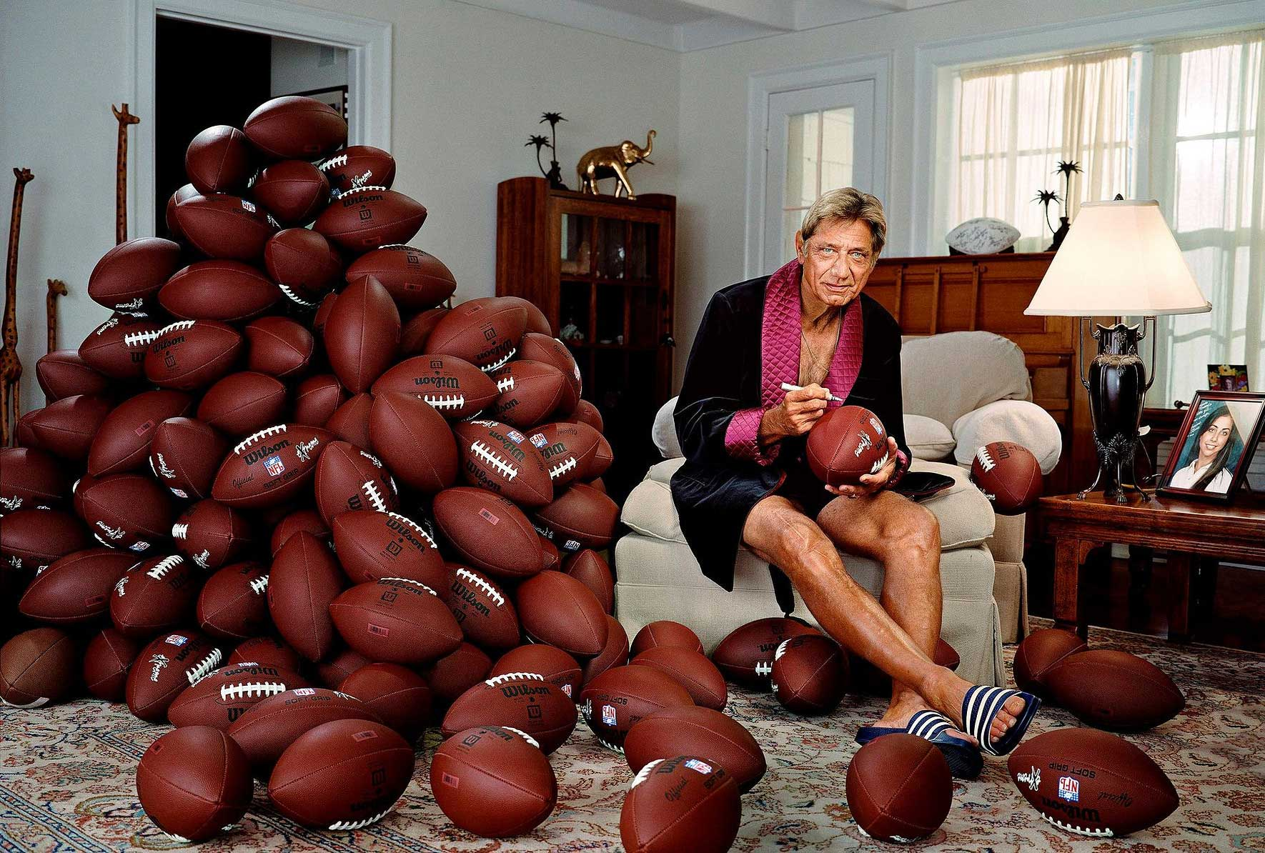 Joe Namath.                                                               Again [being from Germany], I had never heard of him before. What retired athletes do, the famous ones, is they often sign baseballs and footballs. I thought: 'How funny would put be if he was beside a pile of footballs signing them?' We set up the balls. It's one frame. There is no retouching on them.                                                              It was for GQ so normally he would be looking sharp in a suit [but] it was in Florida and I brought that robe. He is a funny, outgoing guy, so I thought it would suit him perfectly.