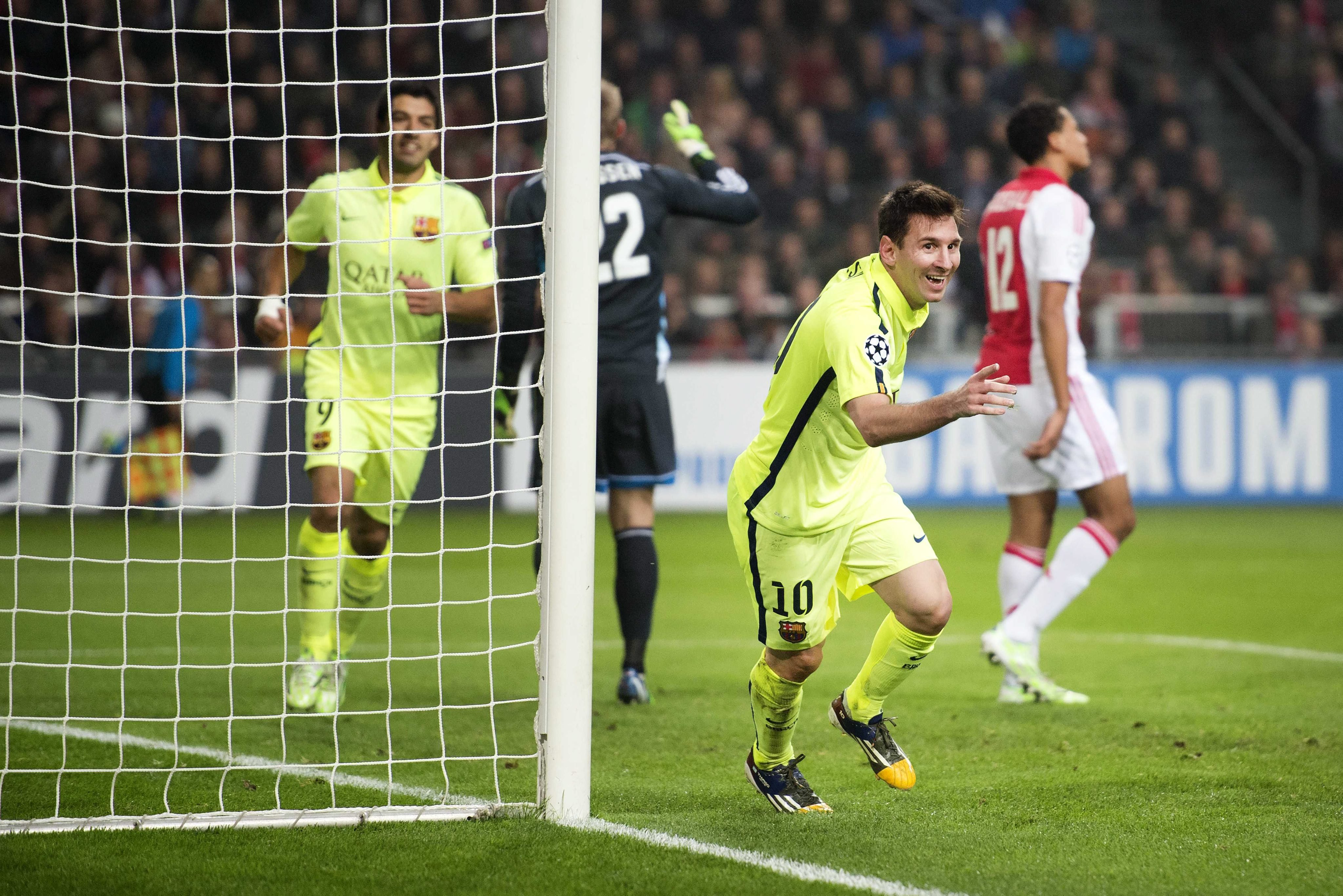 FC Barcelona Lionel Messi celebrates his 2-0 during the UEFA Champions League group F soccer match between Ajax Amsterdam and FC Barcelona in Amsterdam on Nov. 5, 2014.