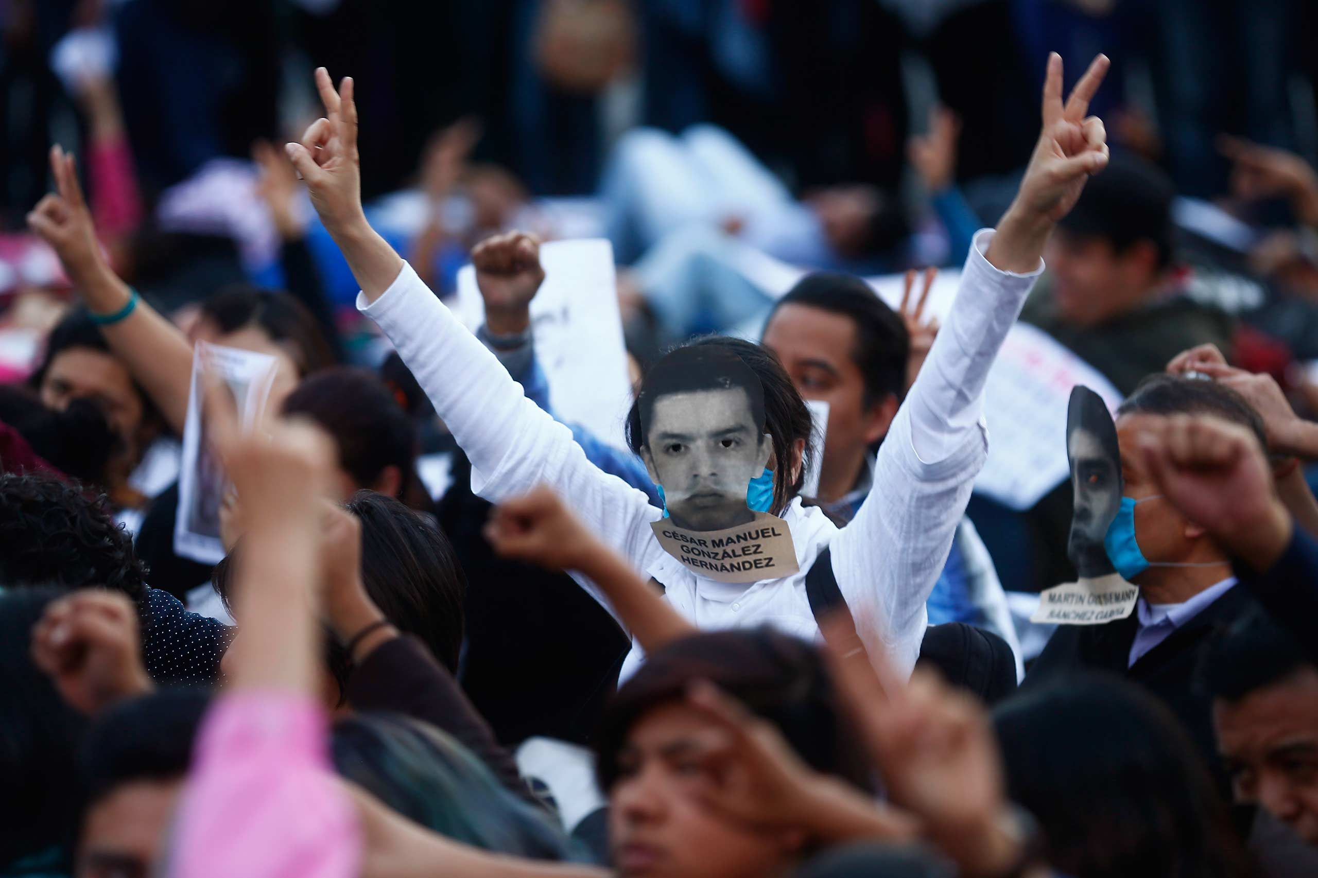 A demonstrator protests at Zocalo square in Mexico City November 8, 2014.