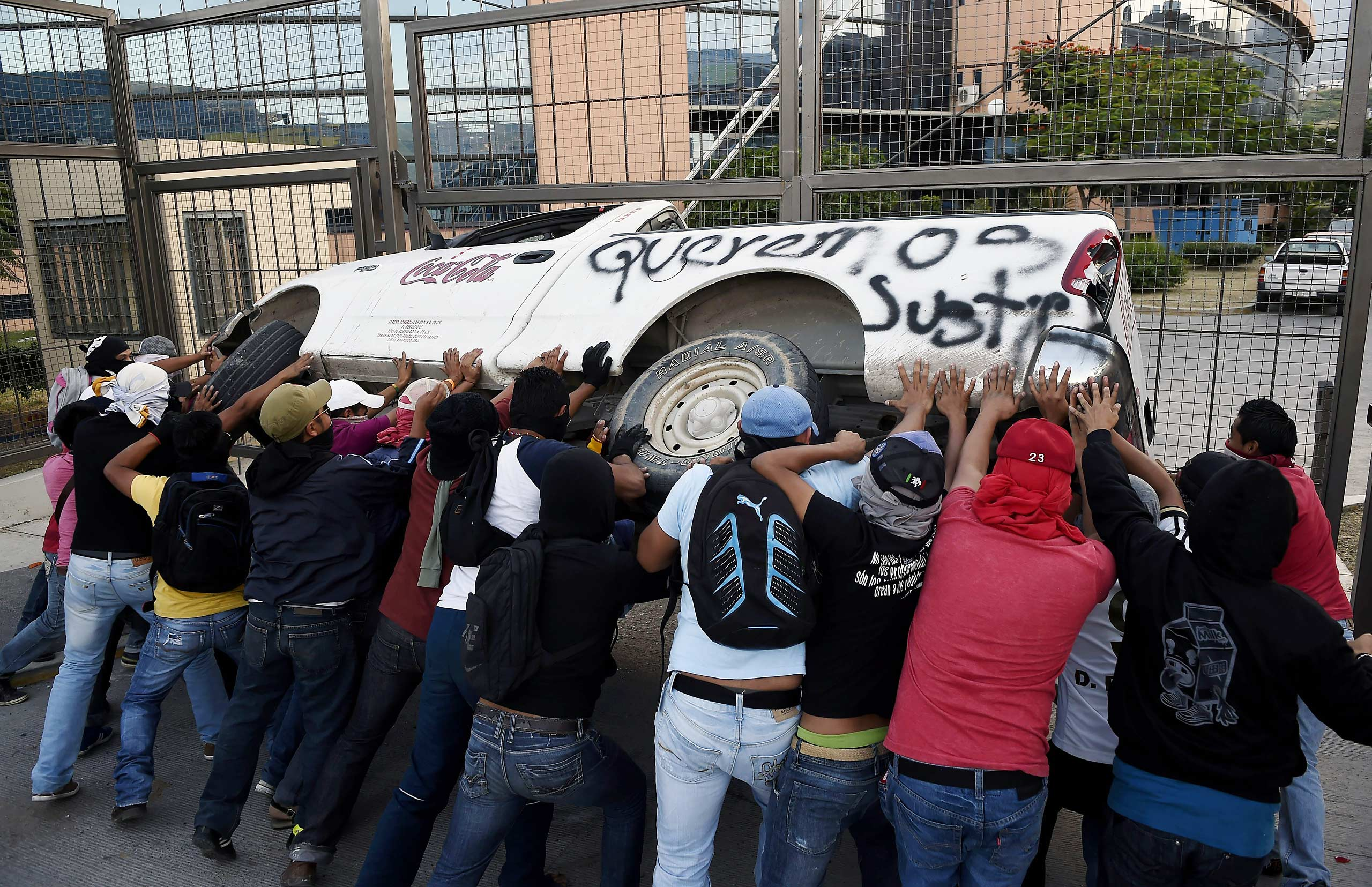 Students from the Ayotzinapa school take part in a protest outside the State Government headquarters in Chilpancingo, Mexico, on November 8, 2014.
