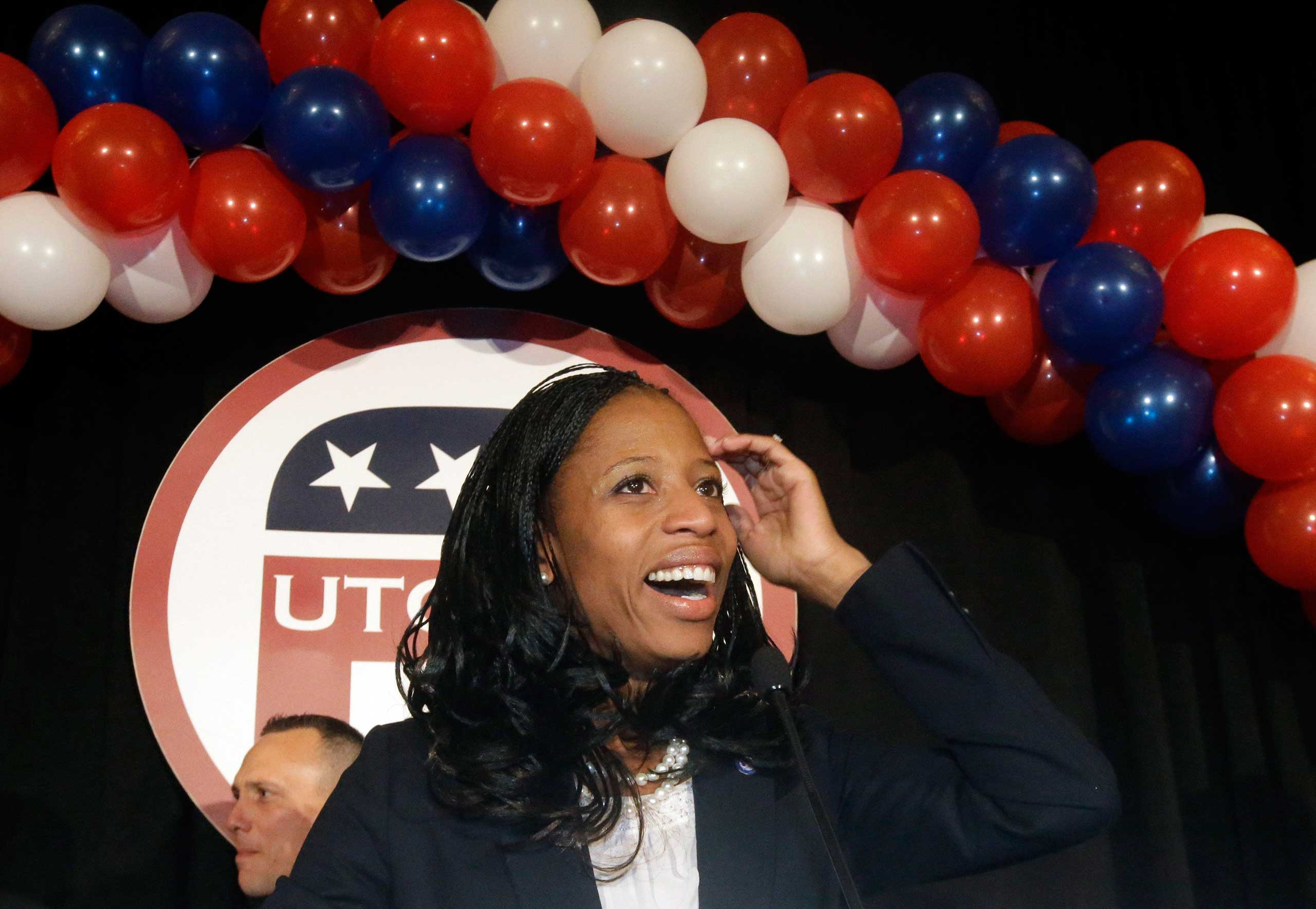 Republican Mia Love celebrates with her supporters after winning the race for Utah's 4th Congressional District during a GOP election night watch party in Salt Lake City on Nov. 4, 2014.