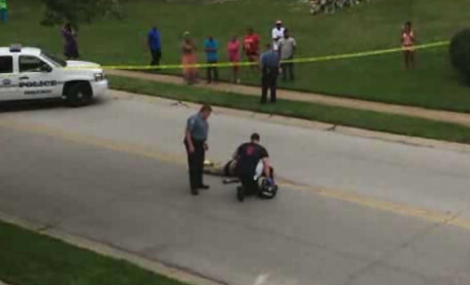 On Aug. 9, 2014, unarmed teenager Michael Brown was fatally shot by Ferguson police officer Darren Wilson. This image provided by KMOV-TV shows investigators inspecting Brown's body.