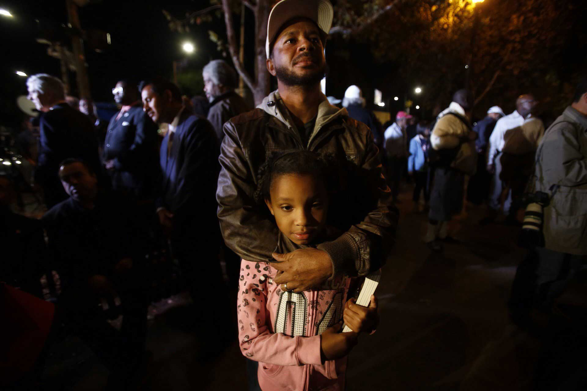 Donald Fields, 37, with daughter Olivia Fields, 9, at a Leimert Park gathering in Los Angeles on Nov. 24, 2014.