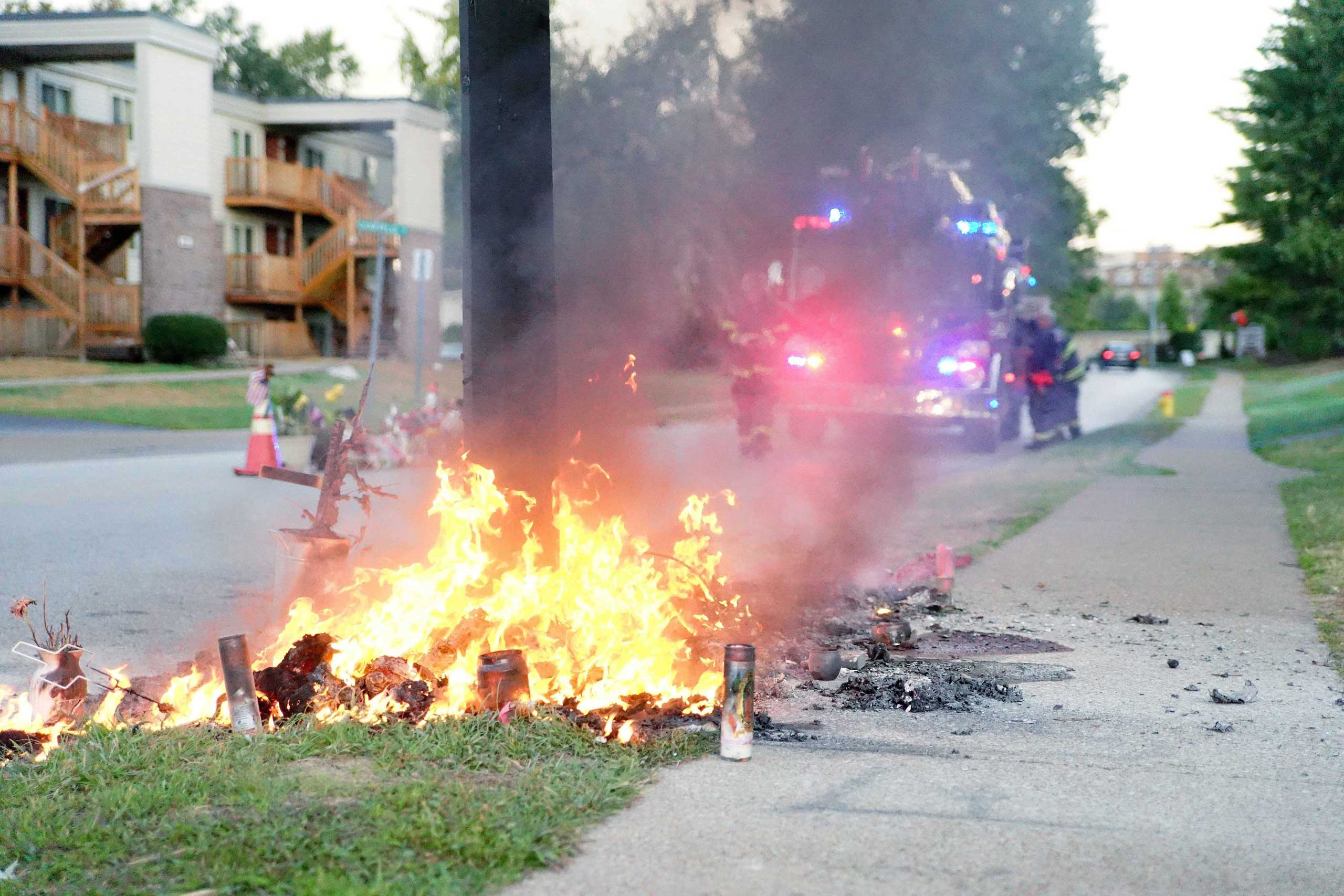 A fire on Sept. 23, 2014 burned a memorial for  Michael Brown on the site where he was killed. The memorial was later rebuilt.