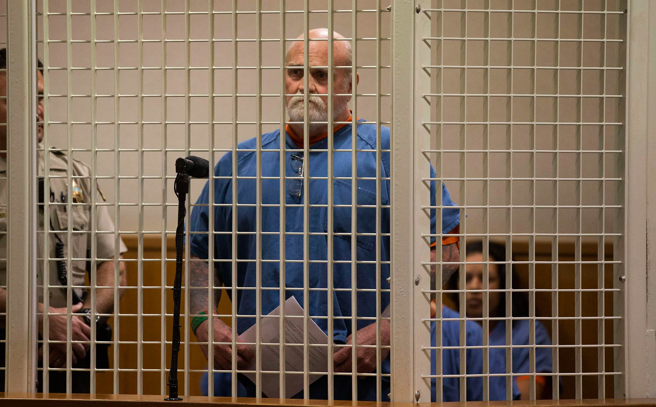 Michael Hanline waits in a cell during a hearing at Superior Court in Ventura, California on November 24, 2014.