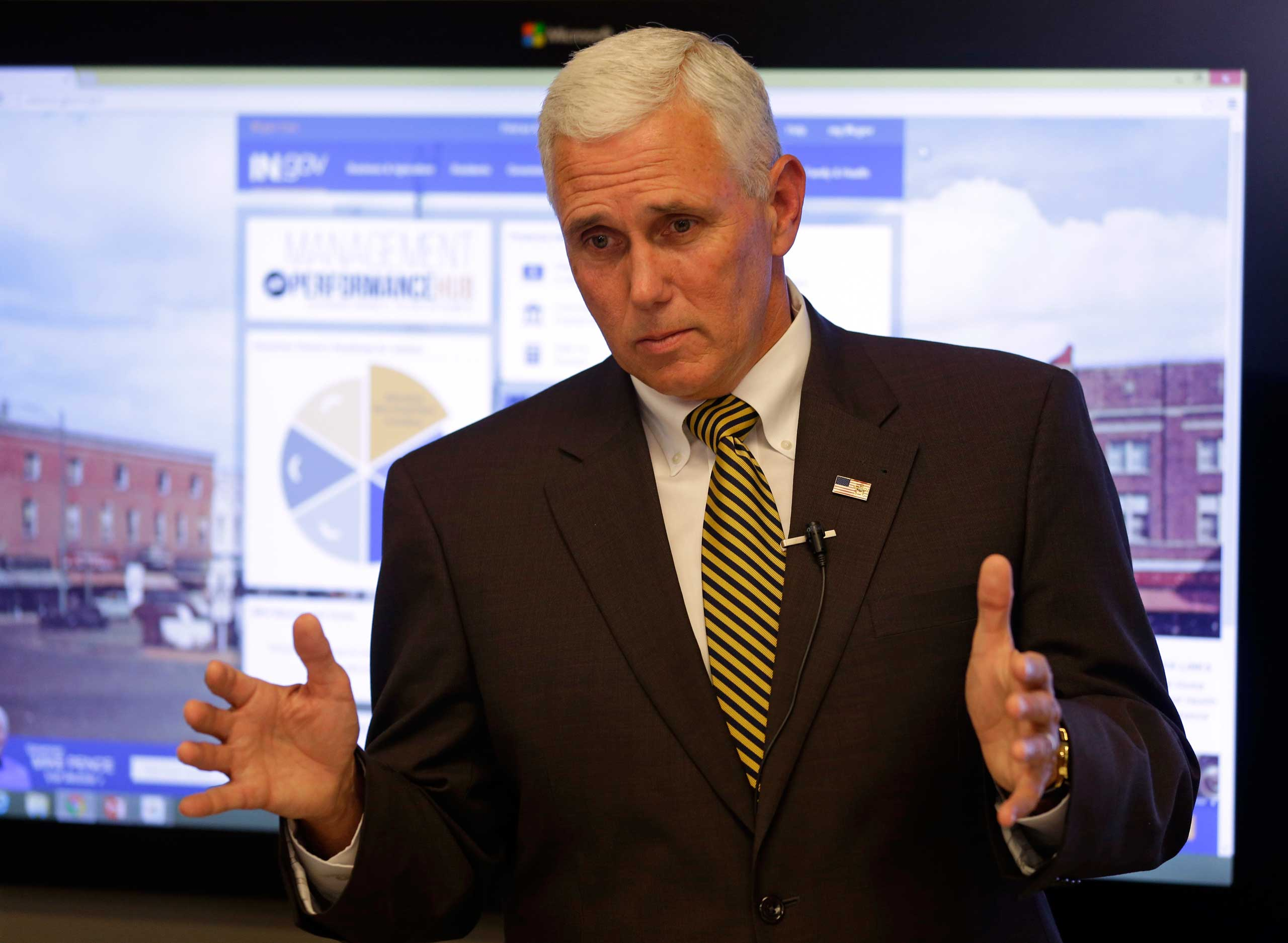 9, 2014, Indiana Gov. Mike Pence answers questions in Indianapolis on Sept. 9, 2014.