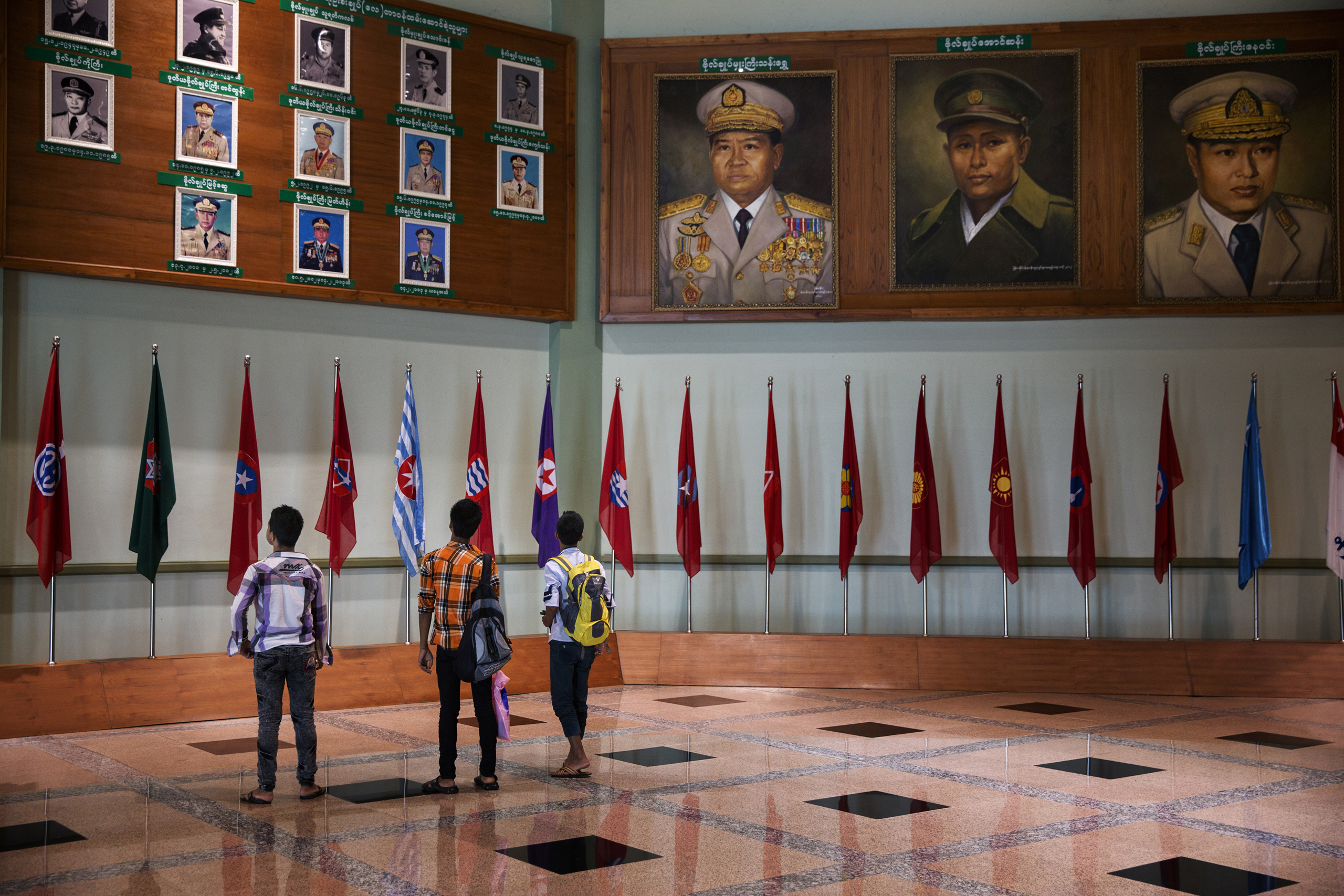 Students visit the Military Museum where  paintings of military leaders hang in Naypyidaw, Burma, Sept. 19, 2014.