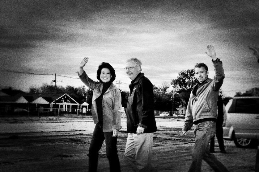 Senator Mitch McConnell with his wife, former Secretary of Labor Elaine Chao and Sen. Rand Paul, in Louisville, Ky., Nov. 3, 2014.