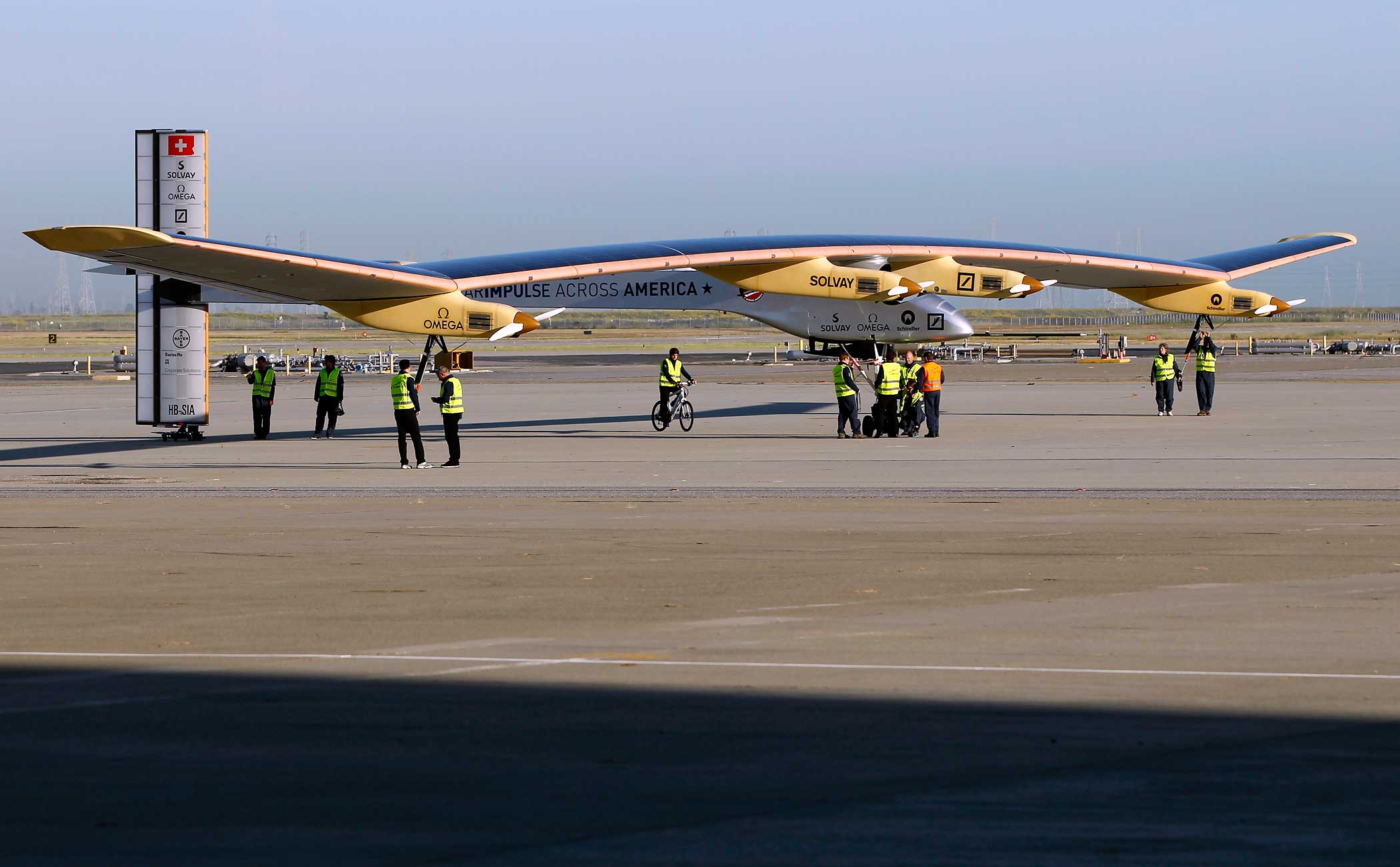 Crew members walk the Solar Impulse to its hangar following a test flight at Moffett Field in Mountain View, California April 19, 2013.