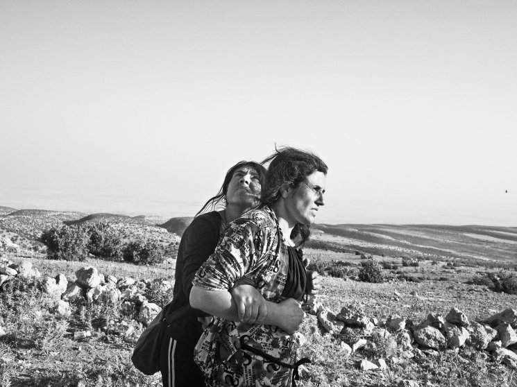 Yezidi women stranded in the Sinjar Mountains wait for the arrival of a rescue helicopter. Iraq. Aug. 12, 2014.