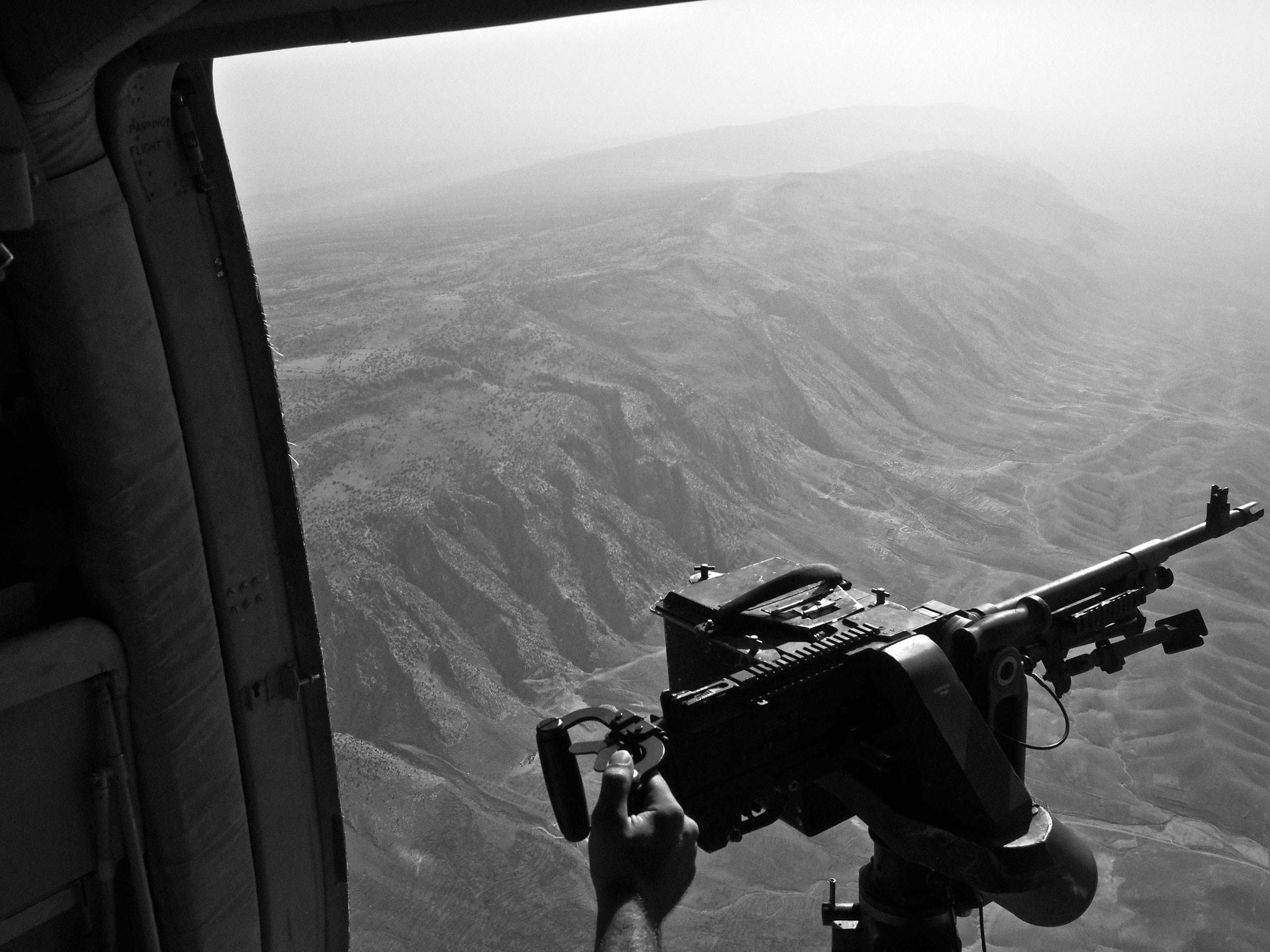 The view from an Iraqi air force helicopter on a rescue mission to drop food and aid to thousands of displaced Yezidis taking refuge in the Sinjar Mountains. Iraq. Aug. 12, 2014.