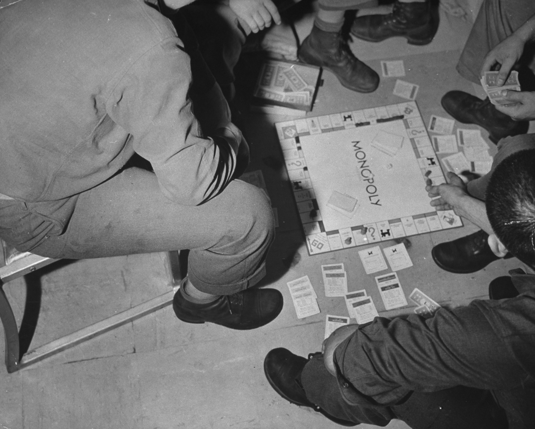 US troops on a transport to Australia playing Monopoly, in 1942