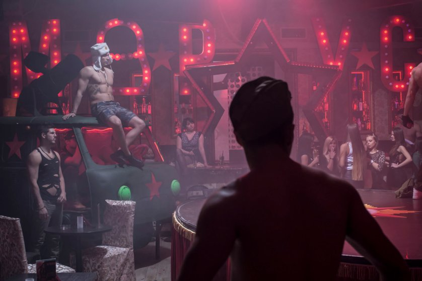 Male workers are seen inside Marusya, a nightclub in Moscow that caters to women.