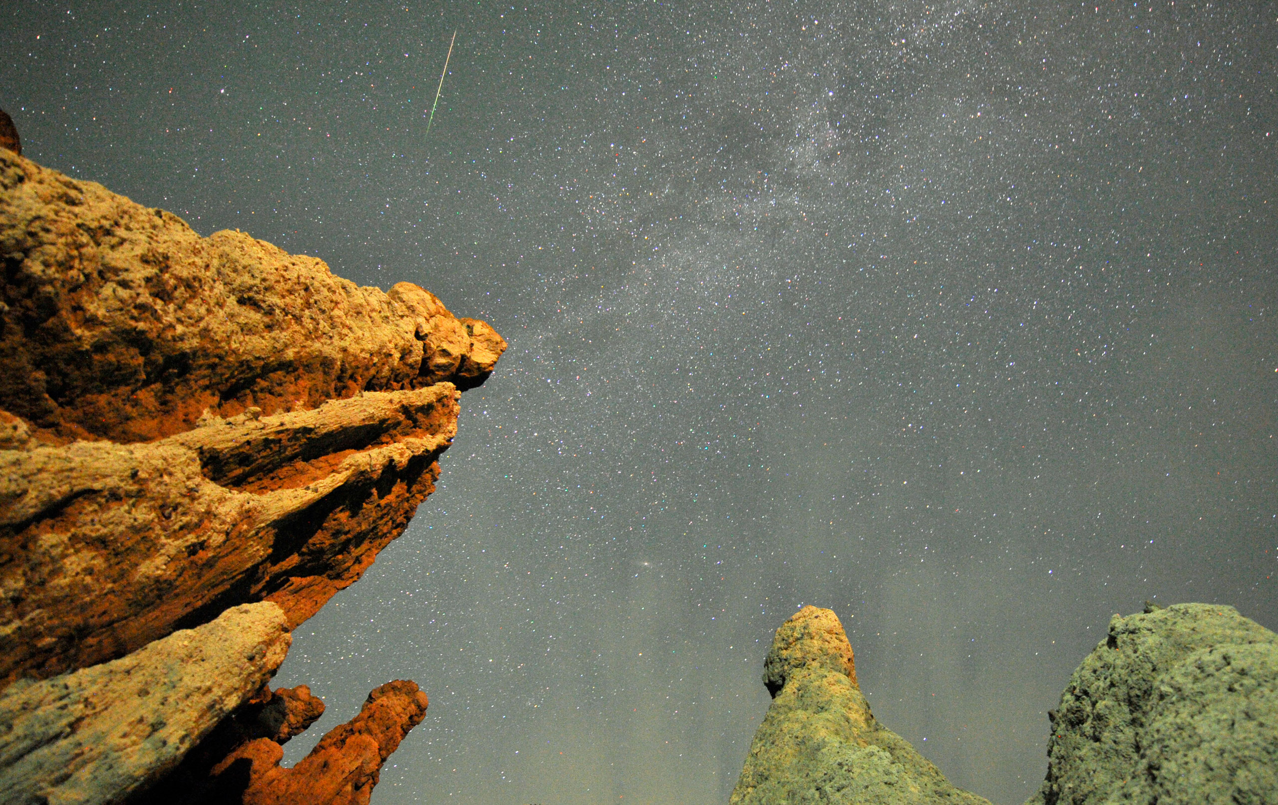 A Perseid meteor streaks past stars in the night sky over the village of Kuklici, known for its hundreds of naturally formed stones, near Kratovo, east of Skopje, on Aug. 13, 2012.