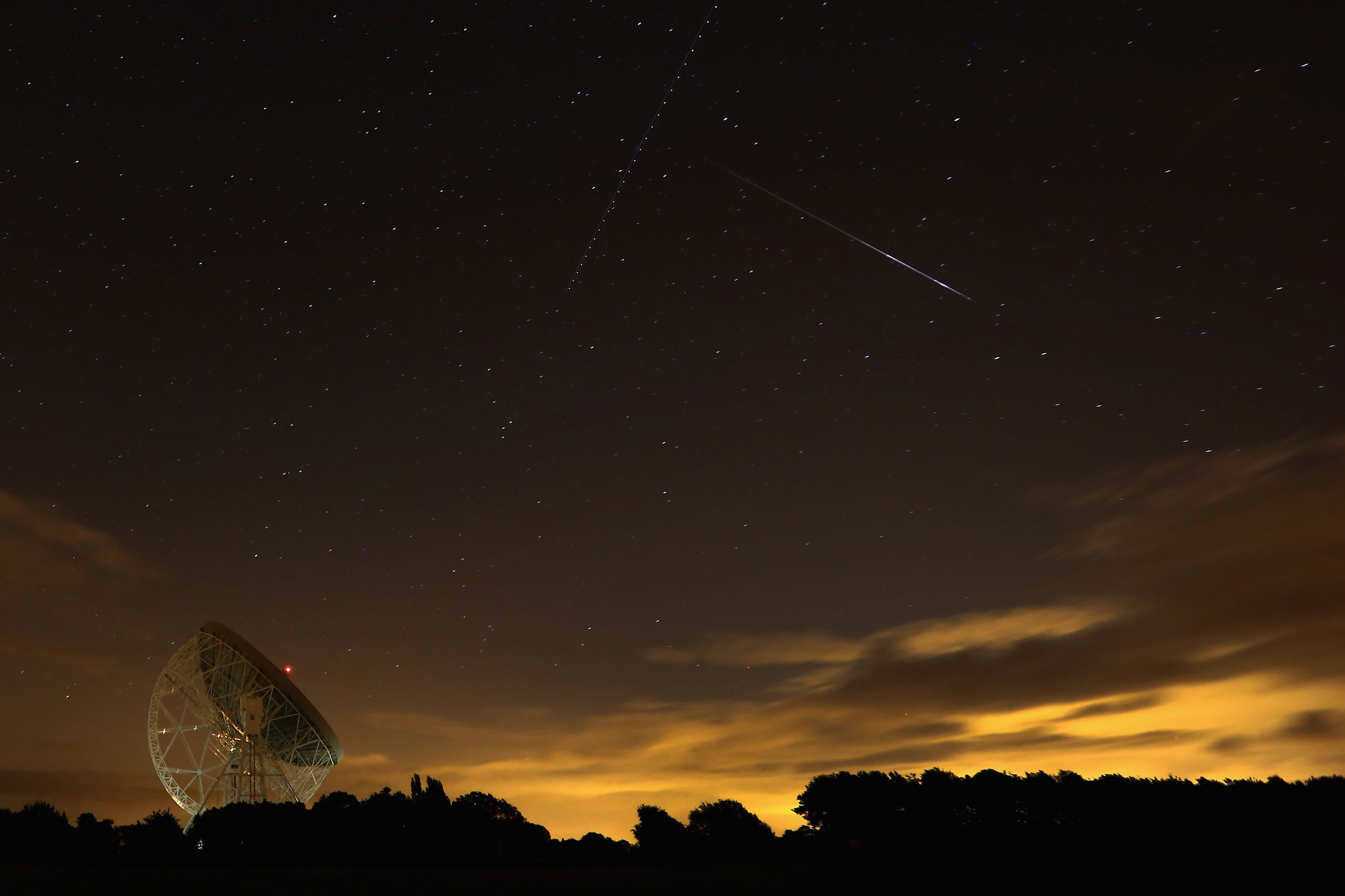 A Perseid meteor streaks across the sky over the Lovell Radio Telescope at Jodrell Bank on Aug. 13, 2013 in Holmes Chapel, England.