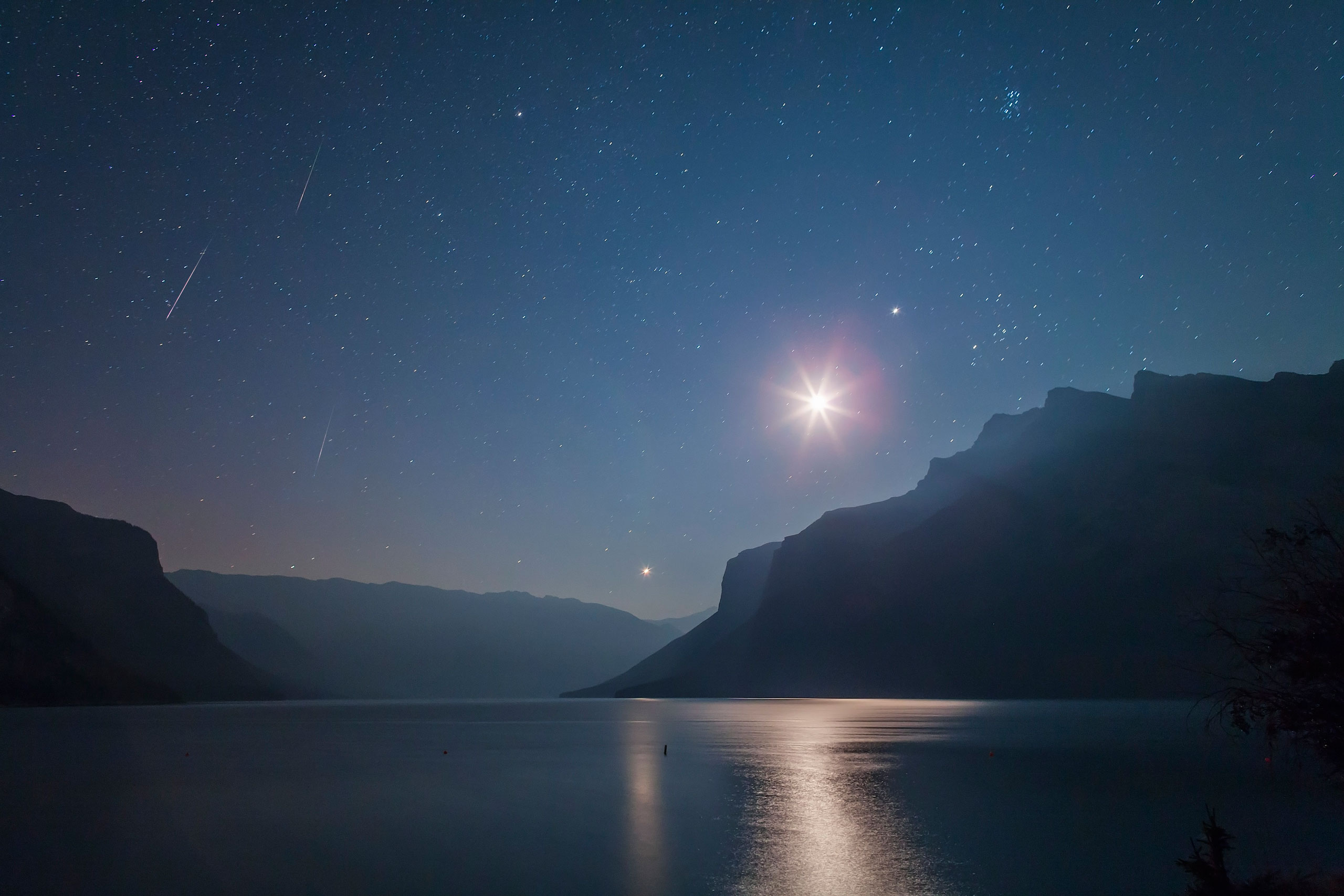 Three Perseid meteors appear in the predawn sky over Lake Minnewanka in Banff National Park, Alberta, Canada on Aug. 12, 2012.