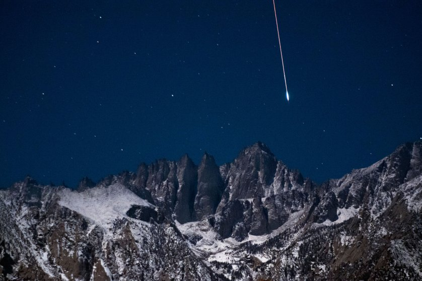 A bright Geminid meteor falls from the sky over the summit of 14,505 foot Mount Whitney in California's Sierra Nevada mountains on Dec. 14, 2011.