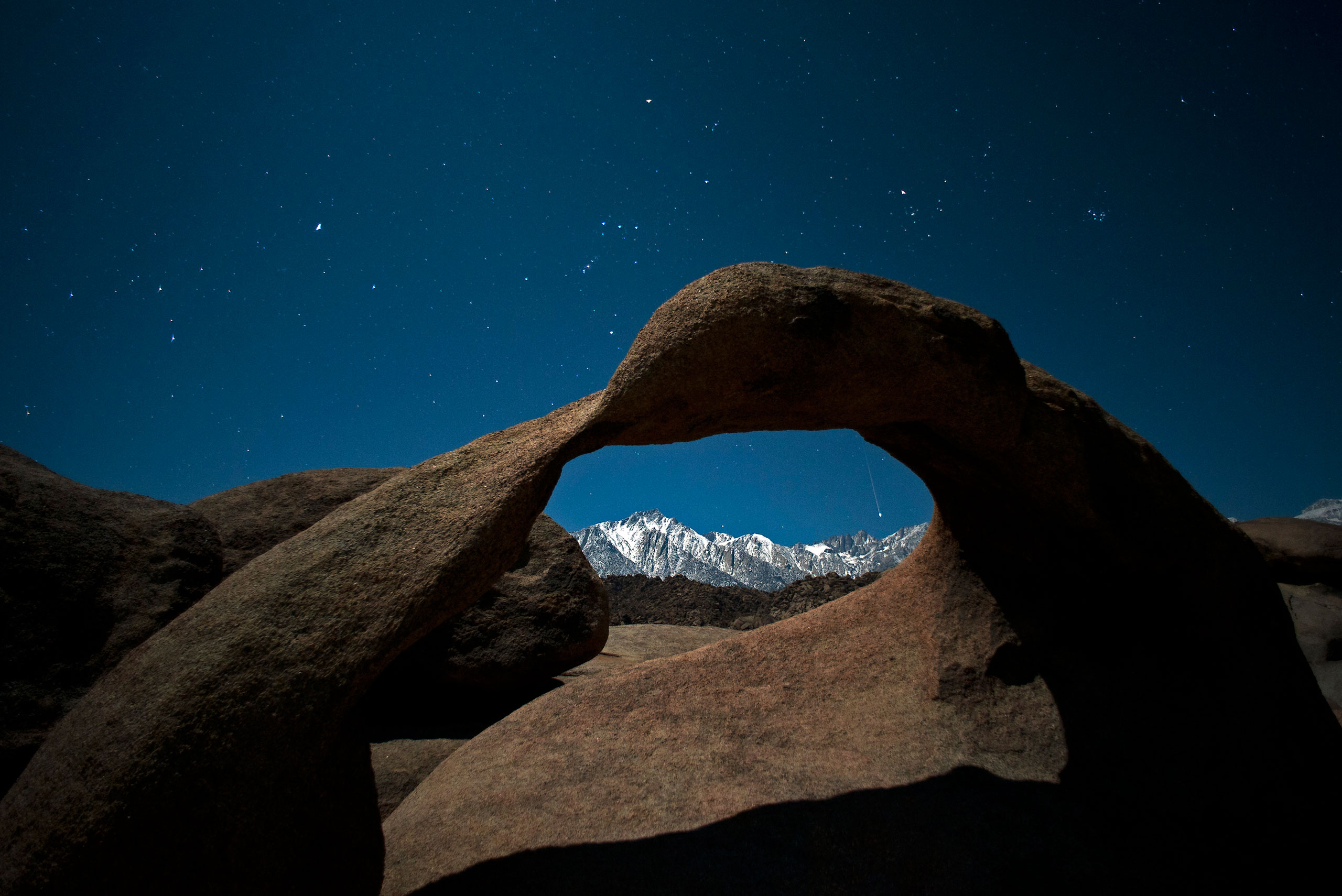 Framed within Mobuis Arch, a Geminid meteor streaks through a starfilled sky above the Sierra Nevada mountains in California's Eastern Sierra on Dec. 14, 2011.