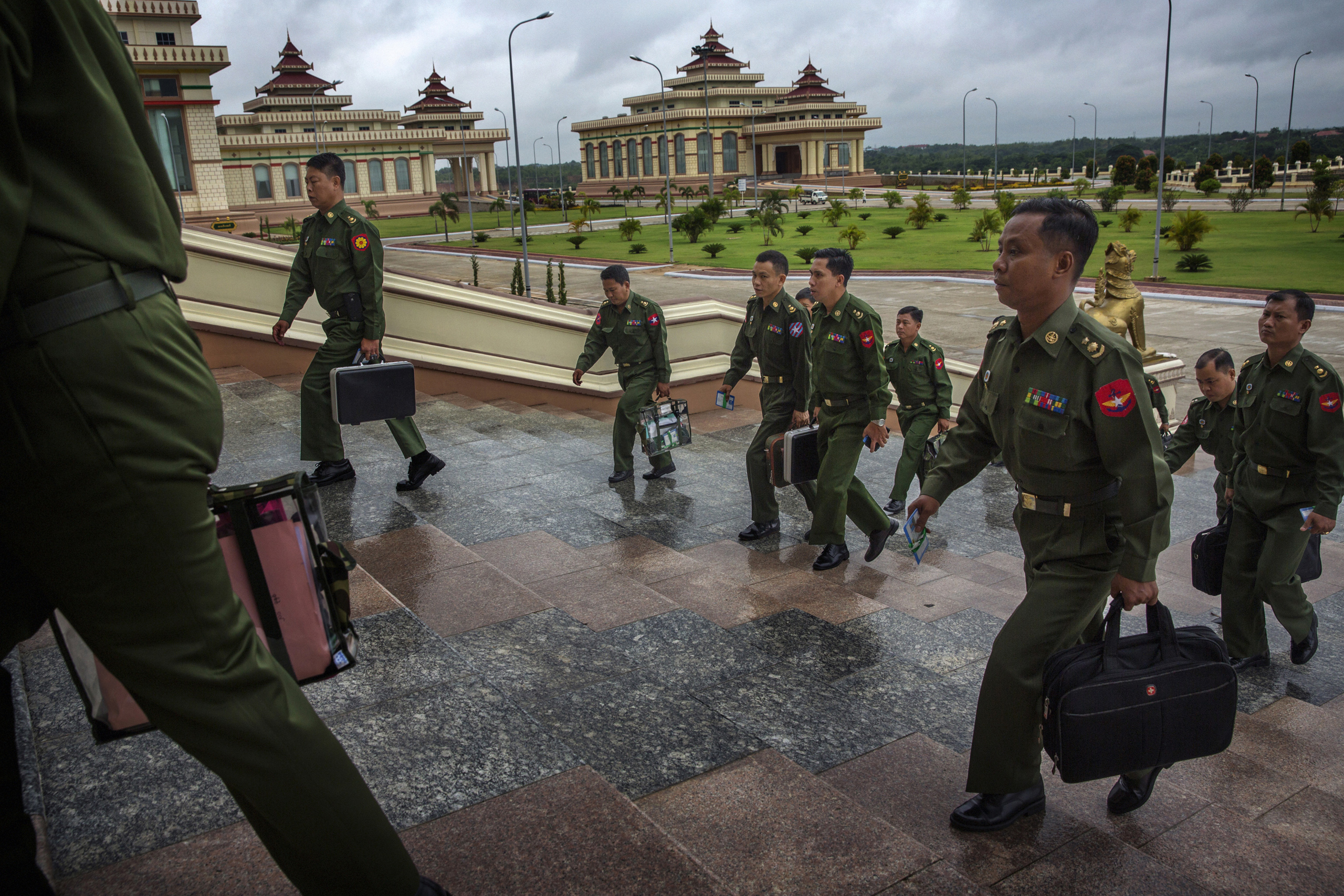 MPs representing the military arrive for a parliamentary session in the Naypyidaw, Burma,  June 20, 2014.
