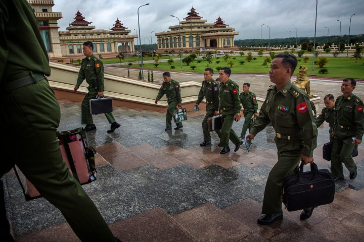 MPs representing the military arrive for a parliamentary session in the Naypyidaw, Burma,  June 20th, 2014.