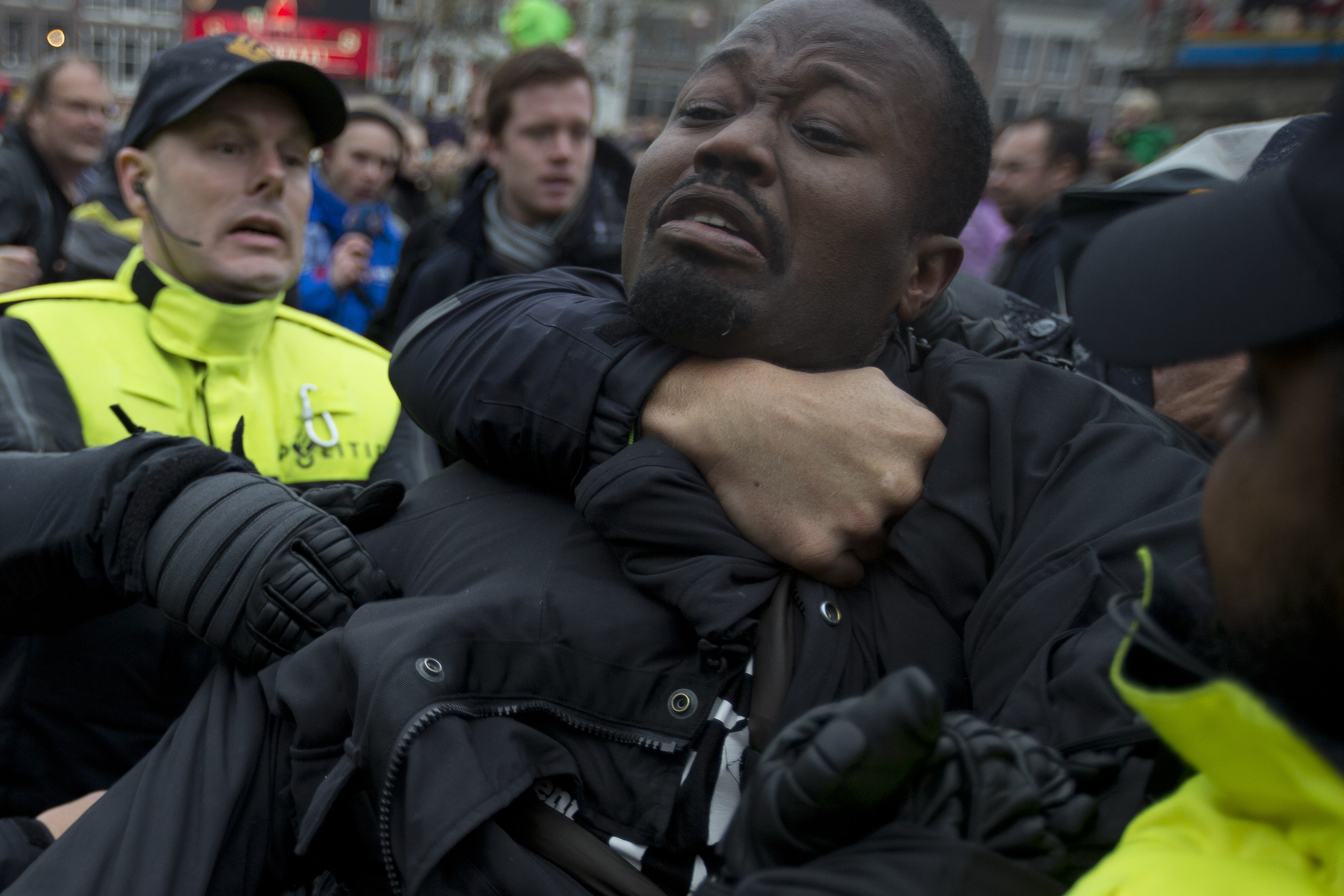 Police detain an anti–Black Pete demonstrator as St. Nicholas arrived in the Dutch city of Gouda on Nov. 15, 2014