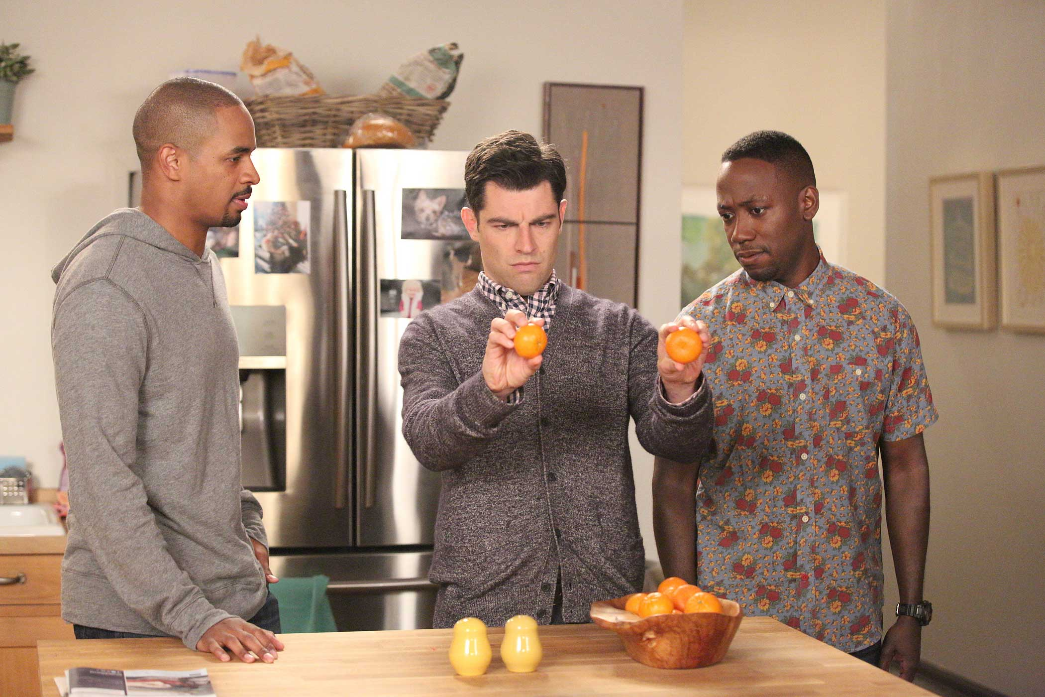 Schmidt (Max Greenfield, center), Coach (Damon Wayans, Jr., left) and Winston (Lamorne Morris) visit their neighbors in the  Goldmine  episode of New Girl.